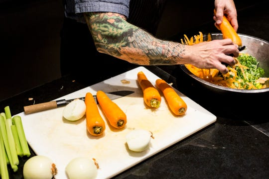 January 08 2019 - David Todd, executive chef at Interim, saves his vegetable peels and scraps to make stock for the restaurant.