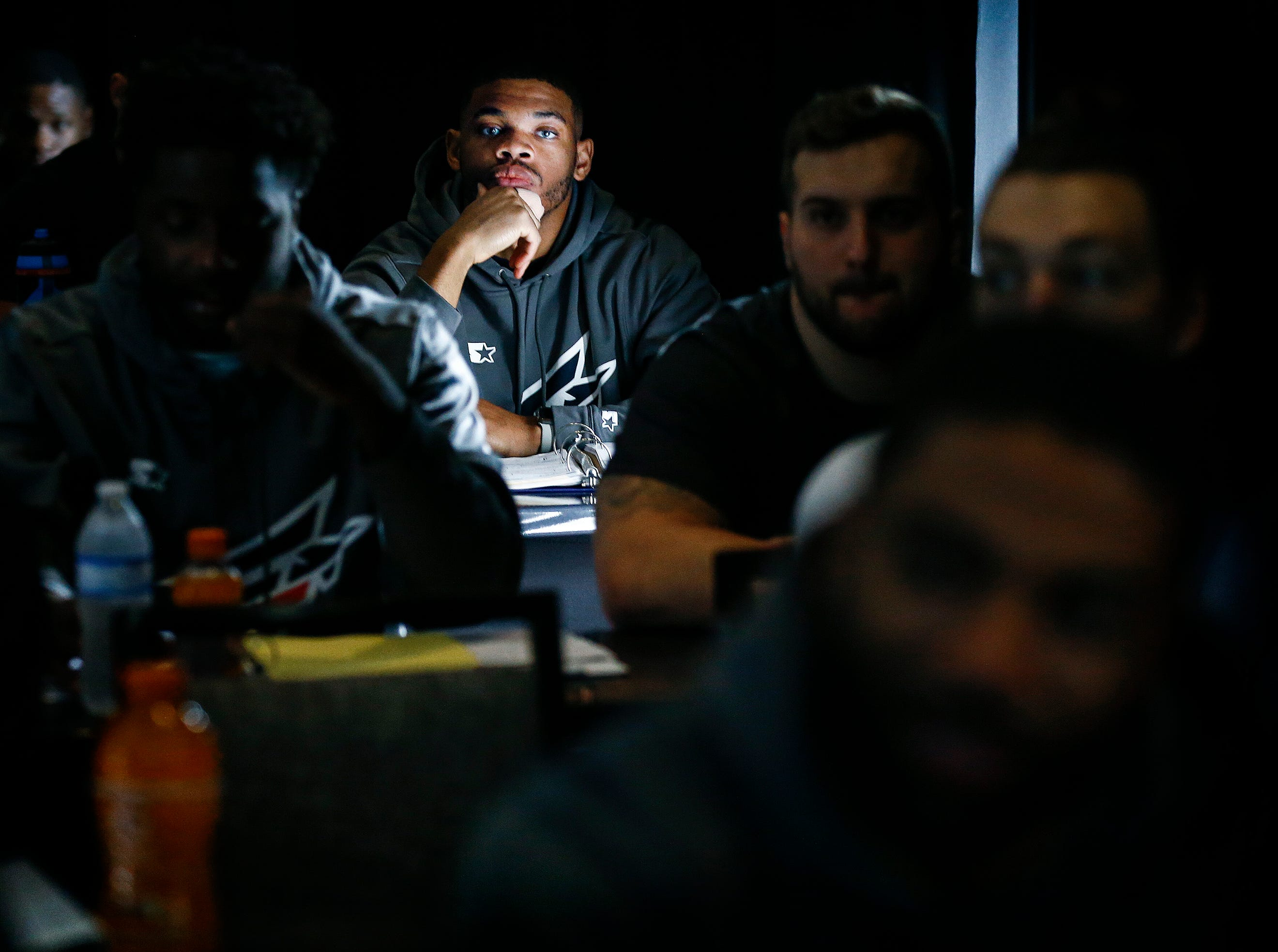 Memphis Express players attend a special teams meeting during training camp in San Antonio, Texas.