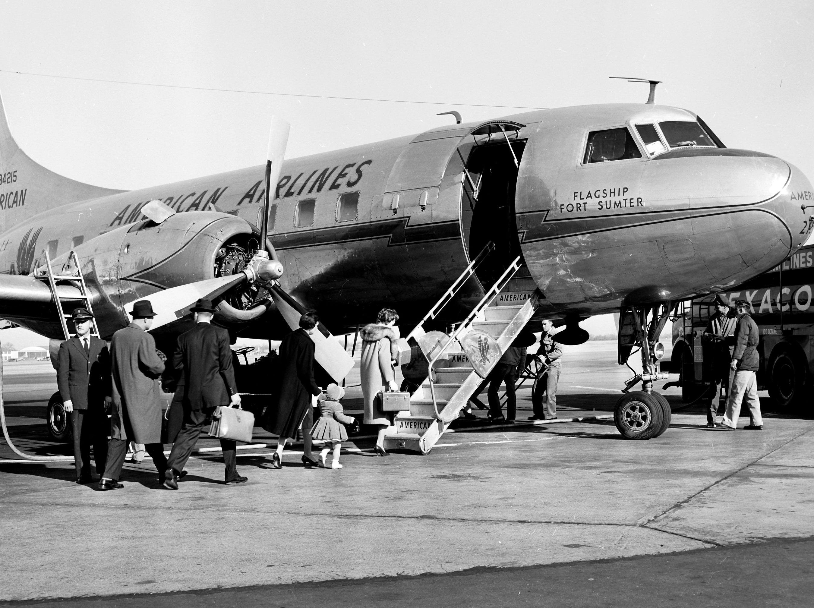 Passengers board the first American Airlines plane to arrive in Memphis in 22 days on 11 Jan 1959, shortly after New York-to-Dallas Flight 405 landed at Municipal Airport.  American's pilots have ended their strike which tied up air travel and idled thousands of the line's employees.