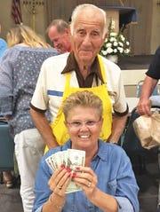 Theresa Linehan, Bingo committee member Dr. Herb Kern., was the big winner at Monday night Bingo.