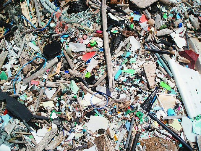 """Debris that washed ashore on Hawaii's  Big Island is seen in 2007. Plastic materials are floating in the Pacific Ocean about 1,000 miles west of San Francisco, in an area known as the North Pacific subtropical gyre. The stretch of sea north of Hawaii, also dubbed the """"Great Pacific Garbage Patch,"""" """"Trash Vortex"""" and """"Rubbish Superhighway,"""" is an example of human impact on oceans. Source:  U.S. National Oceanic and Atmospheric Administration's Marine Debris Program via Bloomberg News"""