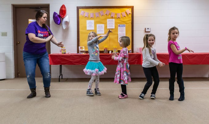 Lake Country Playhouse teaching artist Kathryn Mooers acts out a scene with youngsters during a free, Open House theatre class in Hartland on Monday, Jan. 7, 2019. For more information visit LakeCountryPlayhouseWI.org.