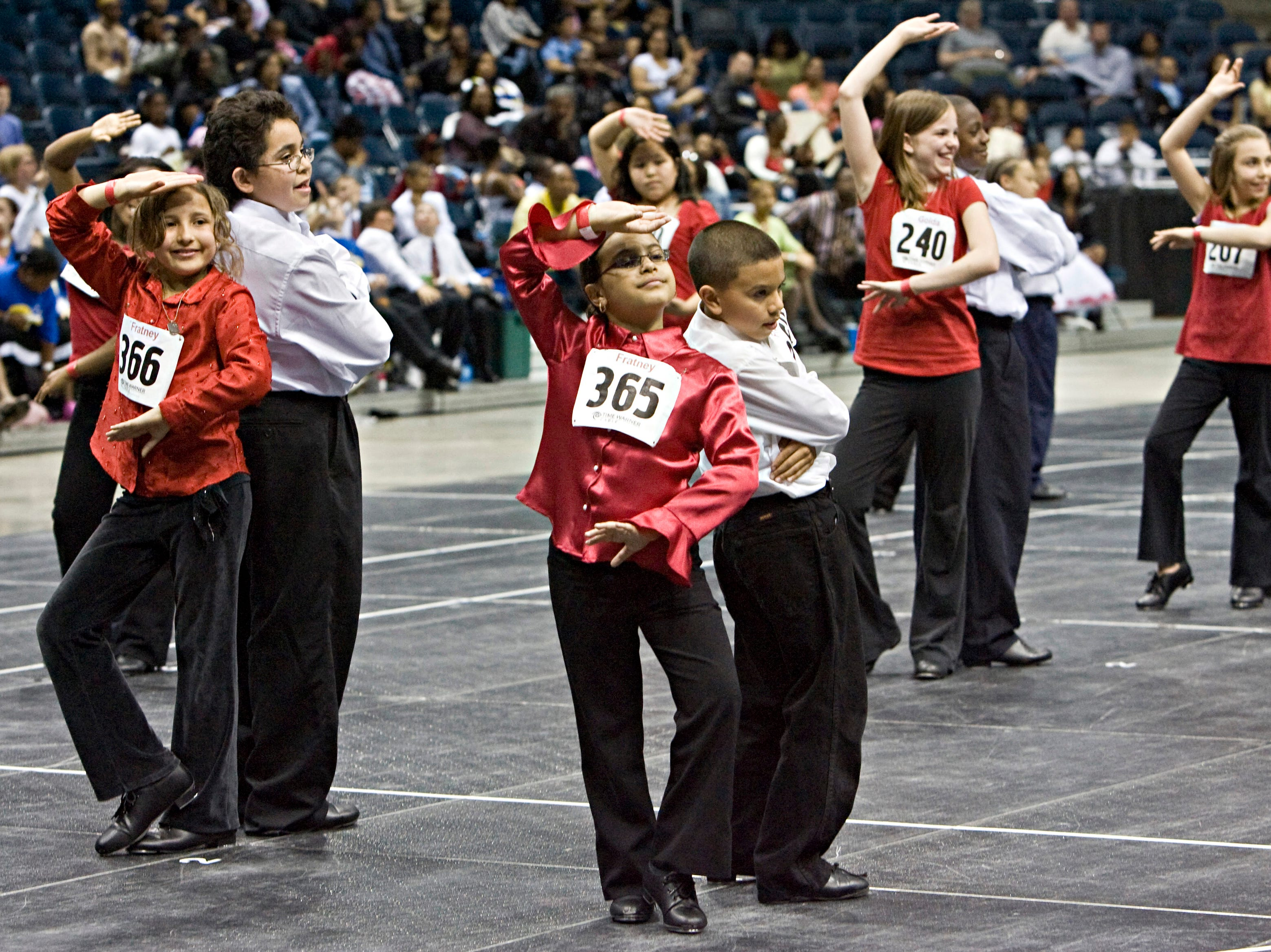 2008: Tap dancers hold their pose after finishing as judges tally their evaluations during the 2nd Annual Mad Hot Ballroom & Tap Competition at the Bradley Center.