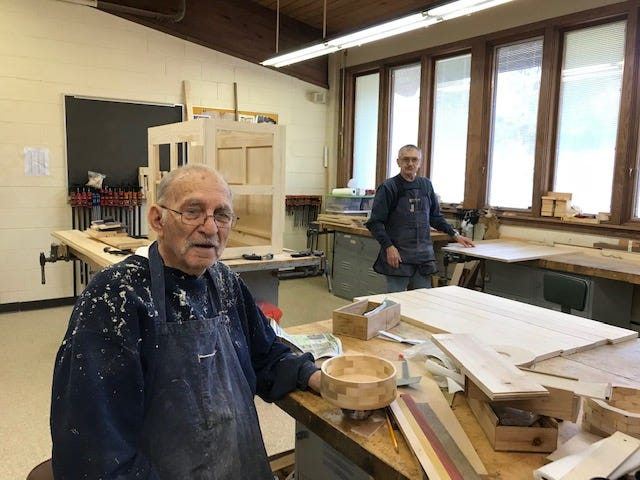 Peter Panzarella (left) and Dennis Schwab inside the woodworking room at Wilson Park Senior Center.