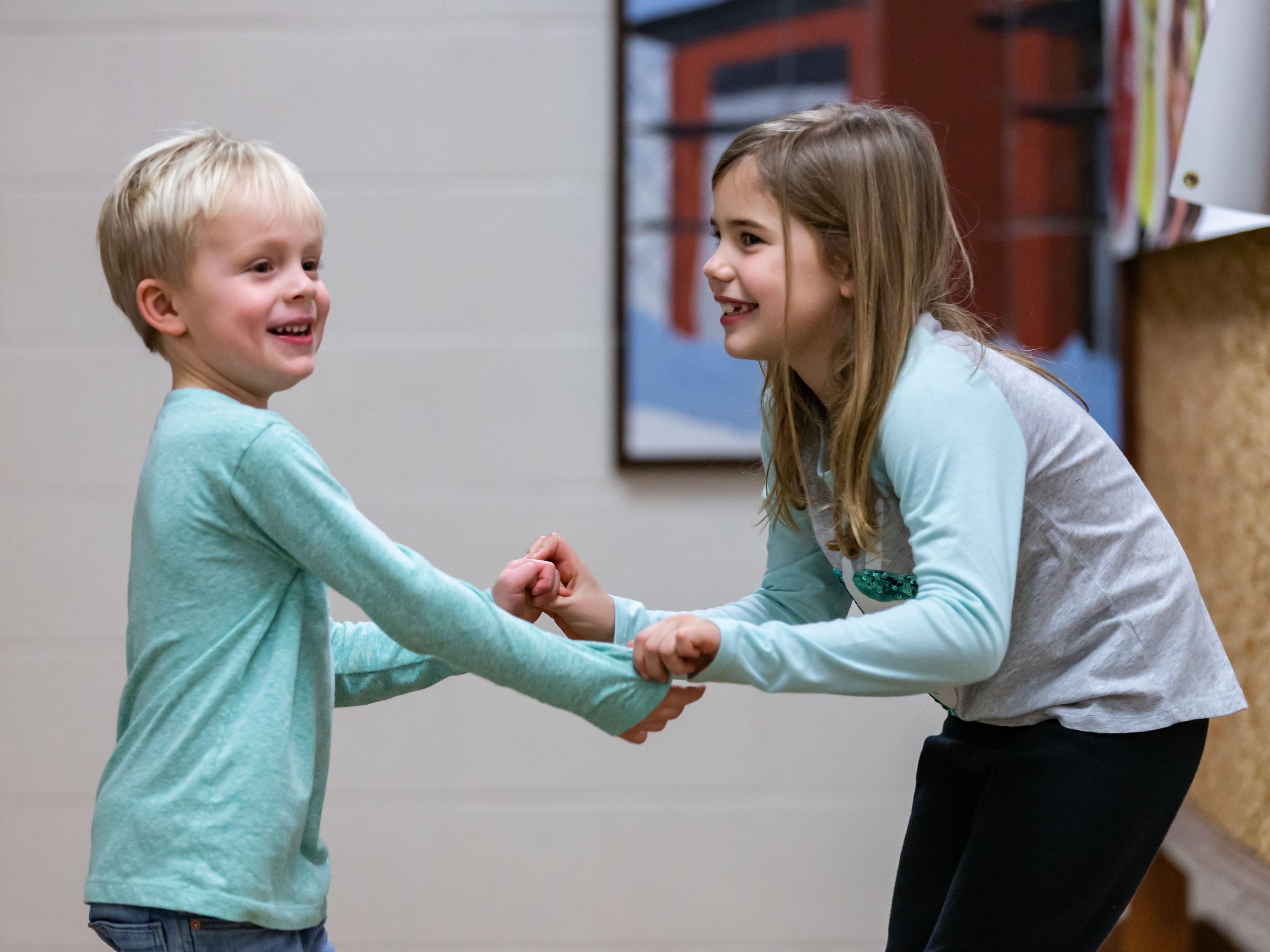Five-year-old Braxton Chapman of Nashotah and Evelyn Borg, 7, of Oconomowoc, act out a scene during a free, Open House theatre class hosted by Lake Country Playhouse in Hartland on Monday, Jan. 7, 2019.