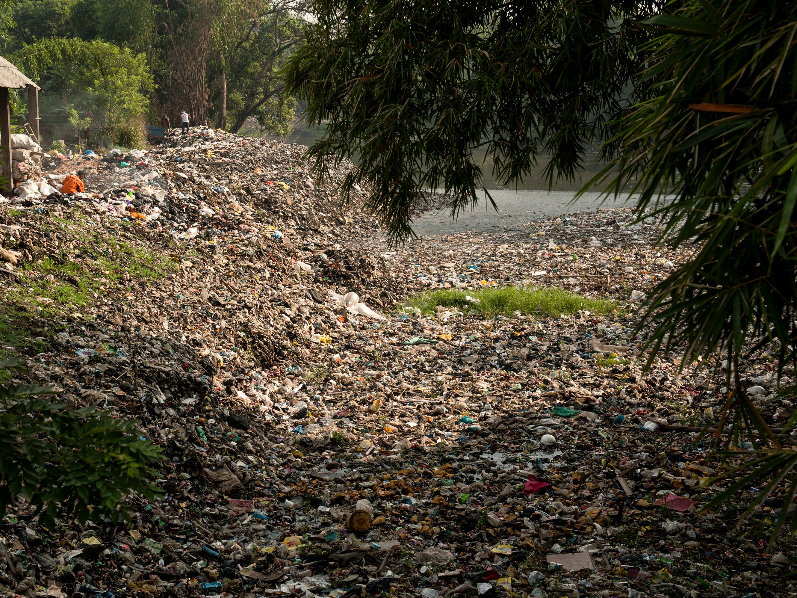 Pollution covers a bank of the Citarum River in Bandung, Indonesia in January 2019. According to reports, Citarum is one of the most polluted rivers in the world, with tons of plastic waste and wastewater, mostly from hundreds of textile factories, disposed directly into the river every day.