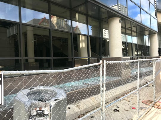 Workers for Viet smashed out the ground level windows at the Bradley Center's main atrium Tuesday morning. The work was done in advance of the roof implosion Sunday at the now-closed arena.