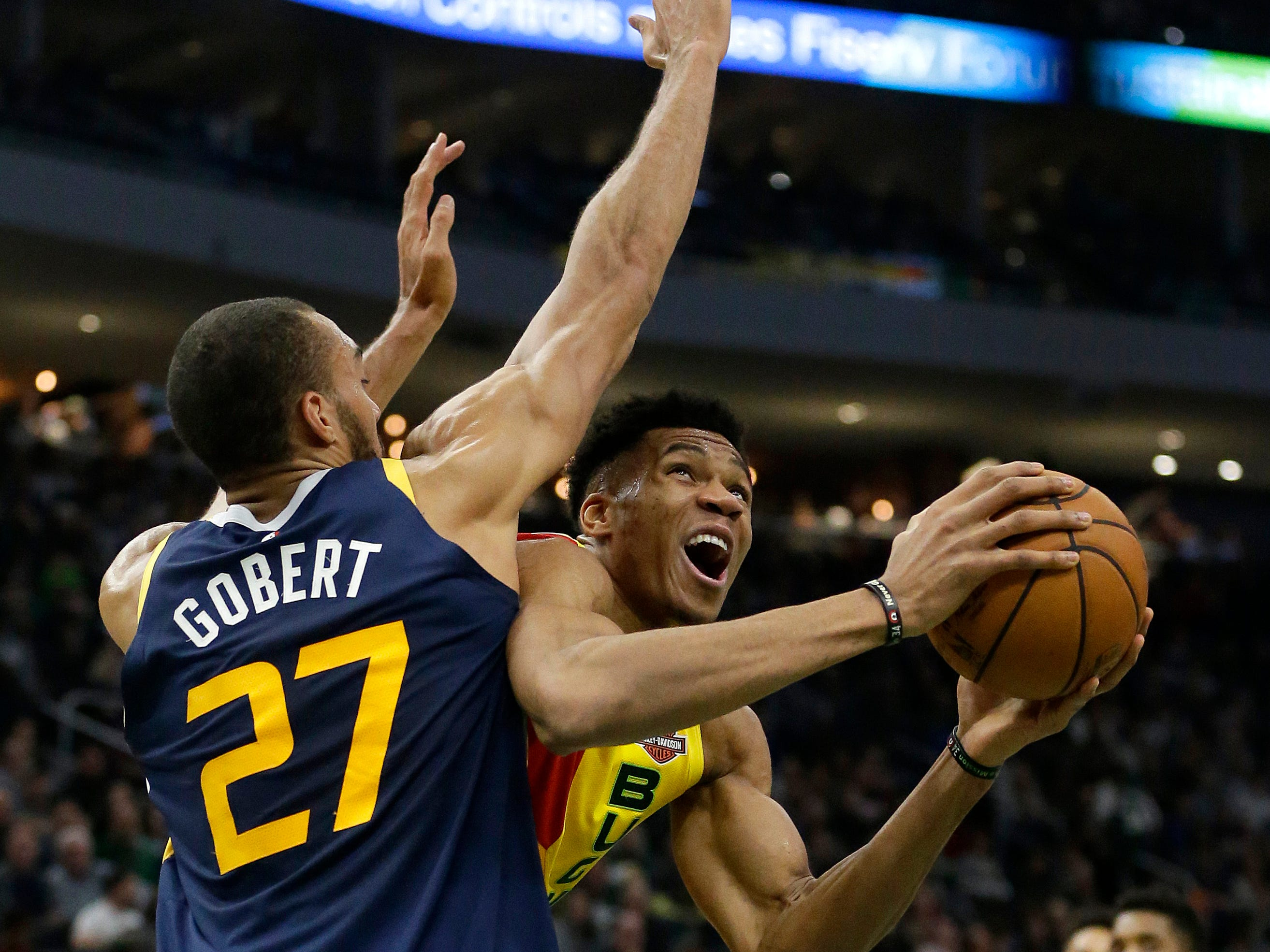 Giannis Antetokounmpo of the Bucks tries to get around the Jazz's Rudy Gobert for a shot on Monday.