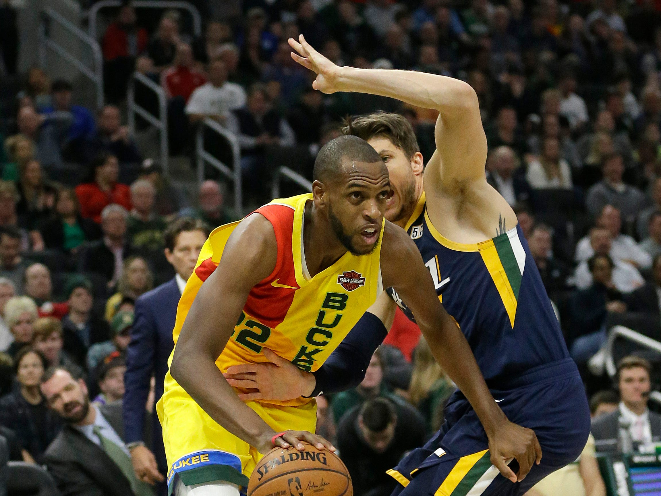 Khris Middleton of the Bucks gets past Kyle Korver of the Jazz as he heads to the basket along the baseline on Monday night.