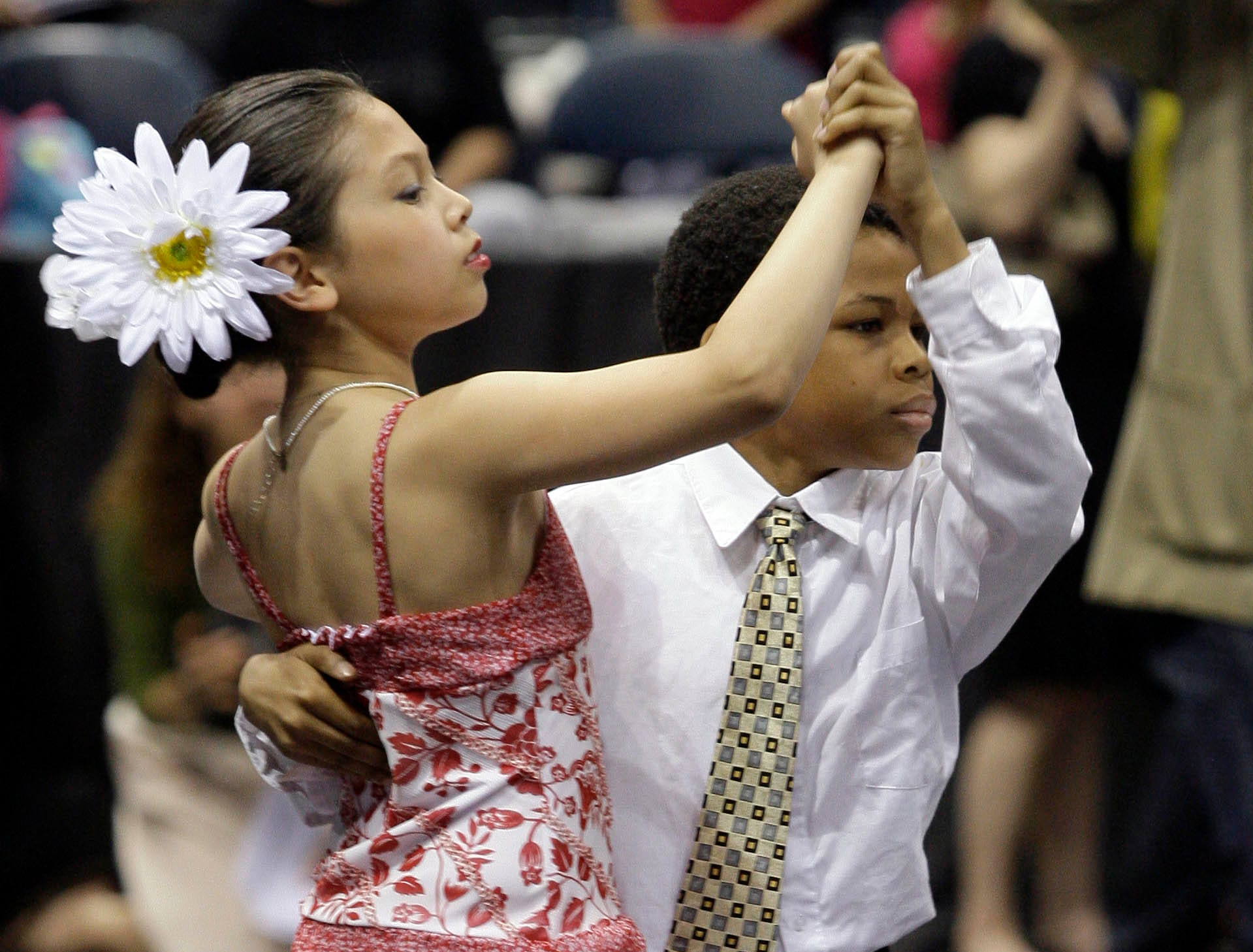 2009: Fifth graders Trevon Bland and Samantha Carter dance the tango during the Third Annual Mad Hot Ballroom and Tap Competition at the Bradley Center.