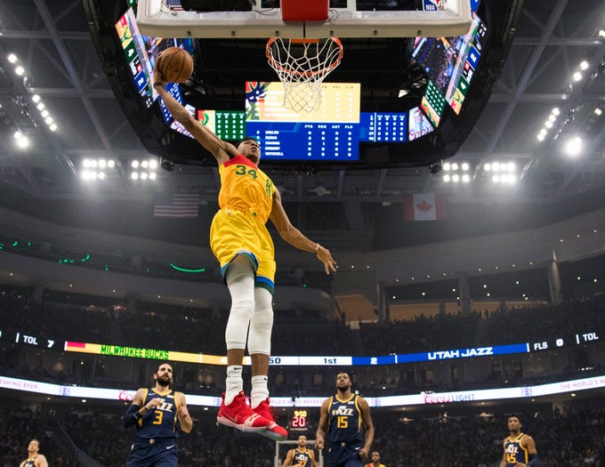 Giannis Antetokounmpo of the Bucks gets ready to finish off a breakaway with a dunk during the first quarter against the Jazz on Monday night at Fiserv Forum.