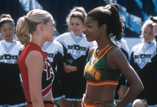 """Cheerleading captains Kirsten Dunst (left) and Gabrielle Union square off in 2000's """"Bring it On."""""""