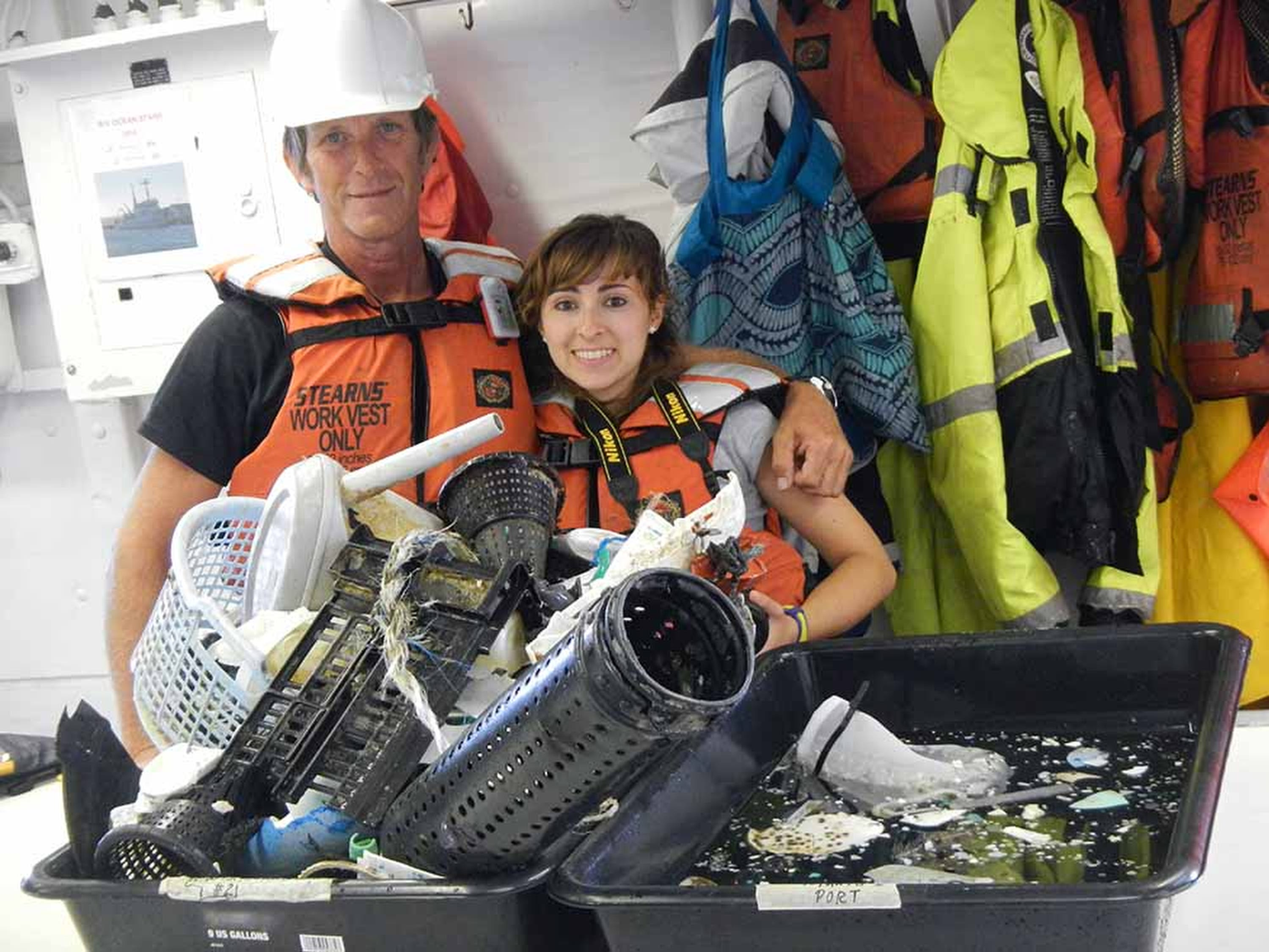 Mega Expedition crew members Mario Merkus and Serena Cunsolo on the R/V Ocean Starr show the results of trawling with one 6 meter-wide net for one hour in the Great Pacific Garbage Patch in 2015. Scientists and volunteers spent a month gathering data on how much plastic garbage is floating in the Pacific Ocean. They say most of the trash is medium to large-sized pieces, as opposed to tiny ones.