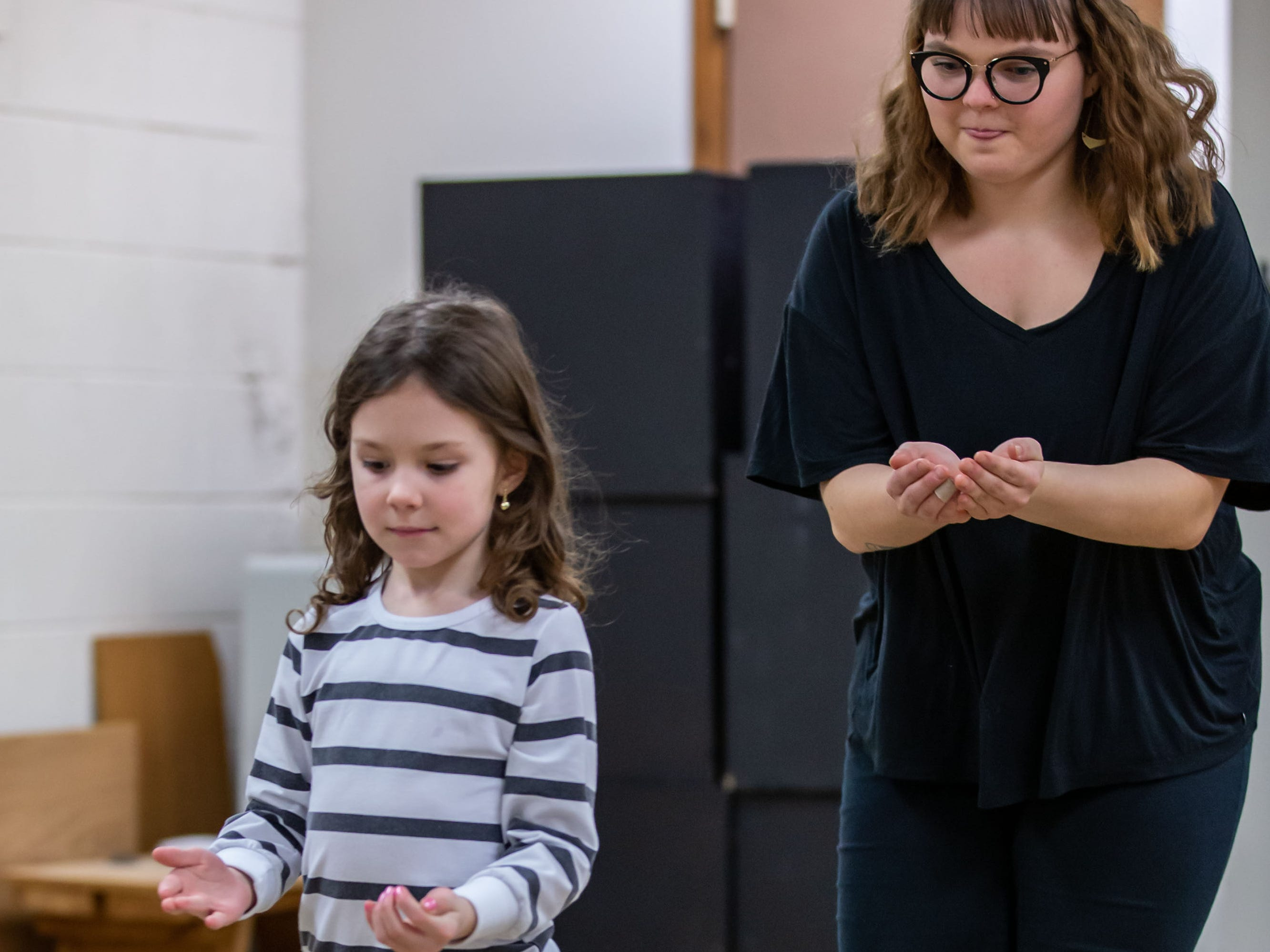 Lake Country Playhouse teaching artist Callyn Klohn acts out a scene with Maclaren Higgins, 6, of Hartland during a free, Open House theatre class on Monday, Jan. 7, 2019.