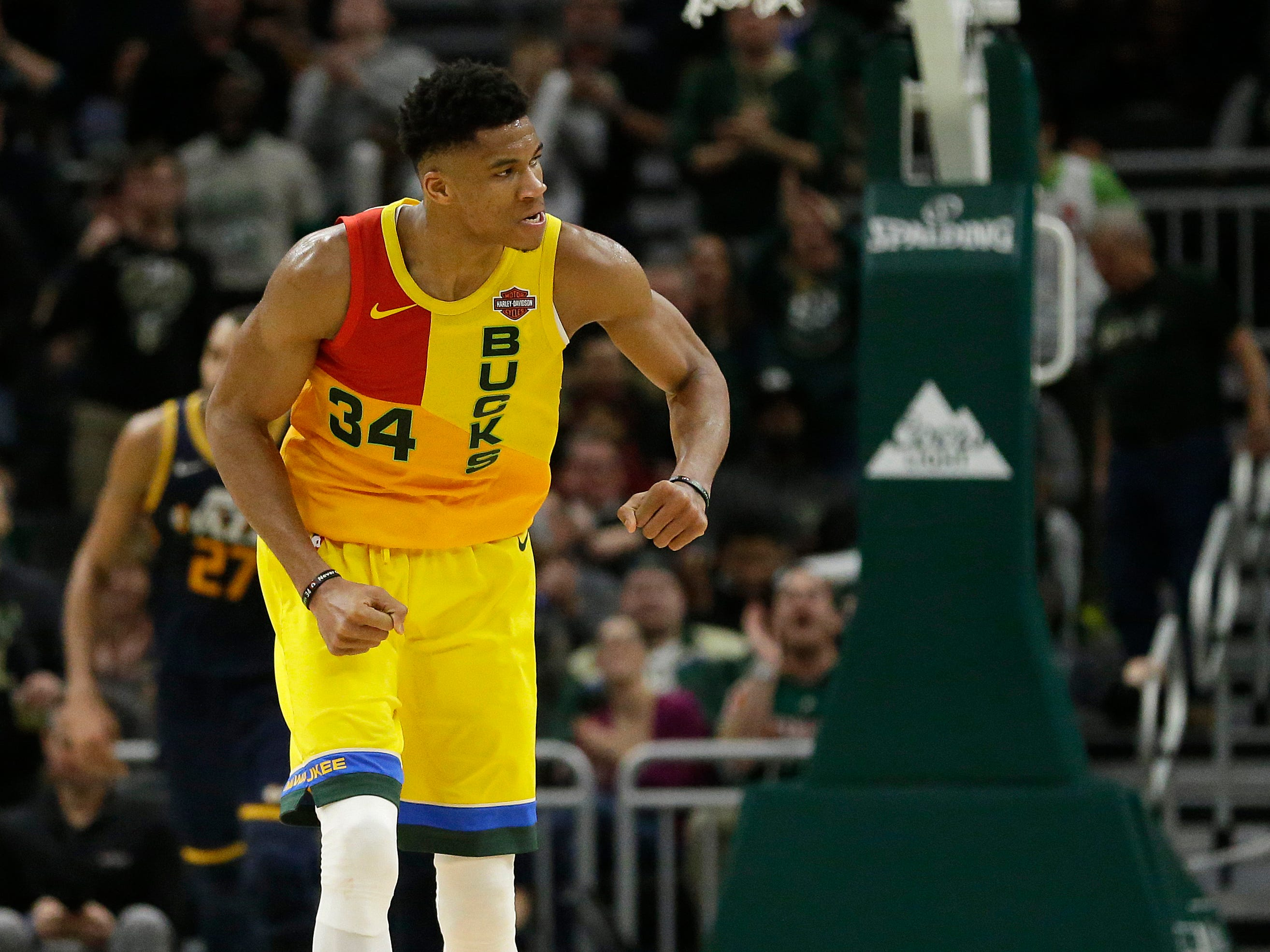 Giannis Antetokounmpo is pummped up after throwing down a dunk against the Jazz during the second half Monday.