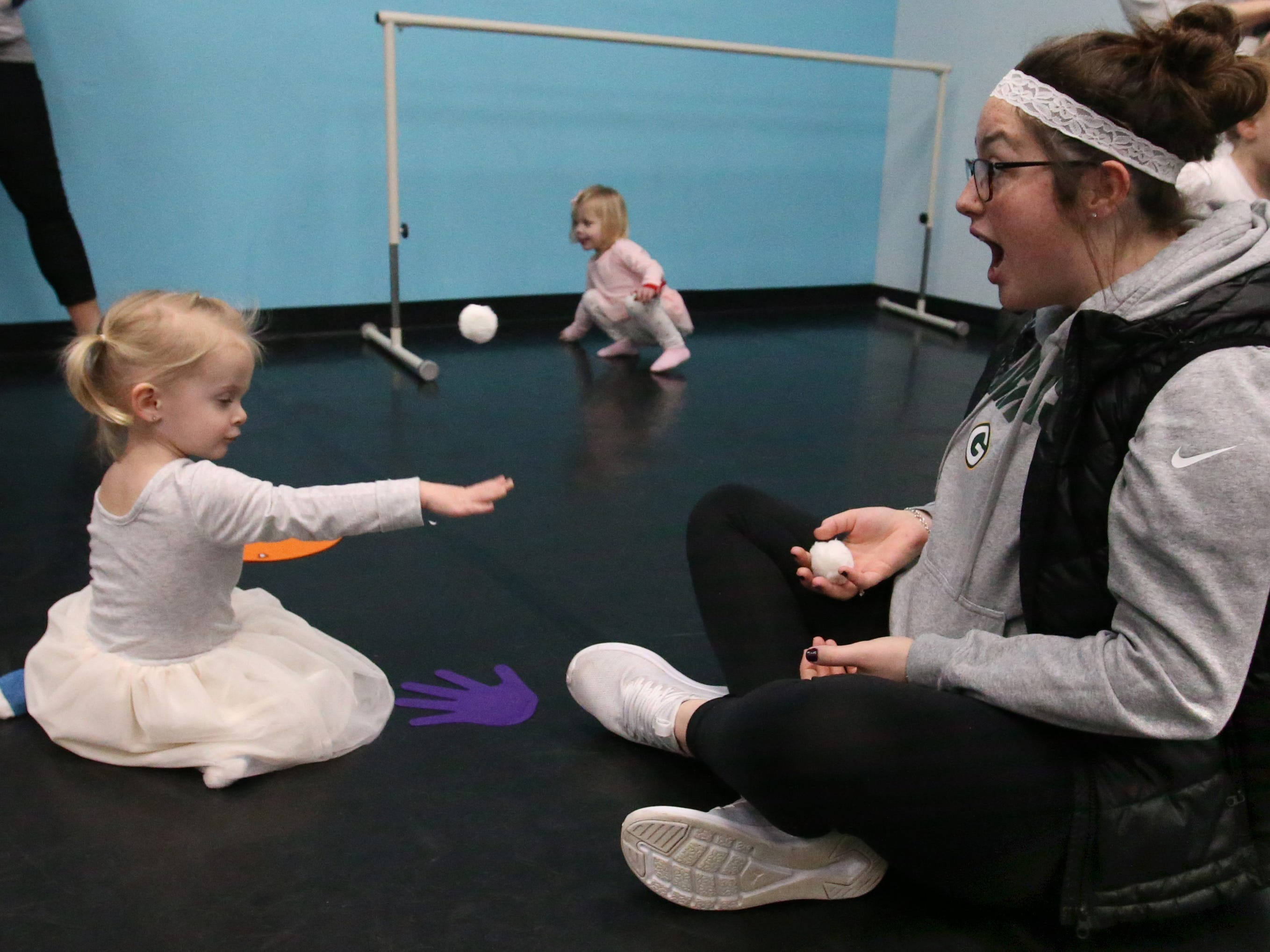 Emmalou Dudley, 2, and Kylie McElderry have a snowball fight with cotton balls during a free Story Time Tuesday for pre-school children that included a book reading, craft activity and play at the Liberty Dance Center in Waukesha on Jan. 8.