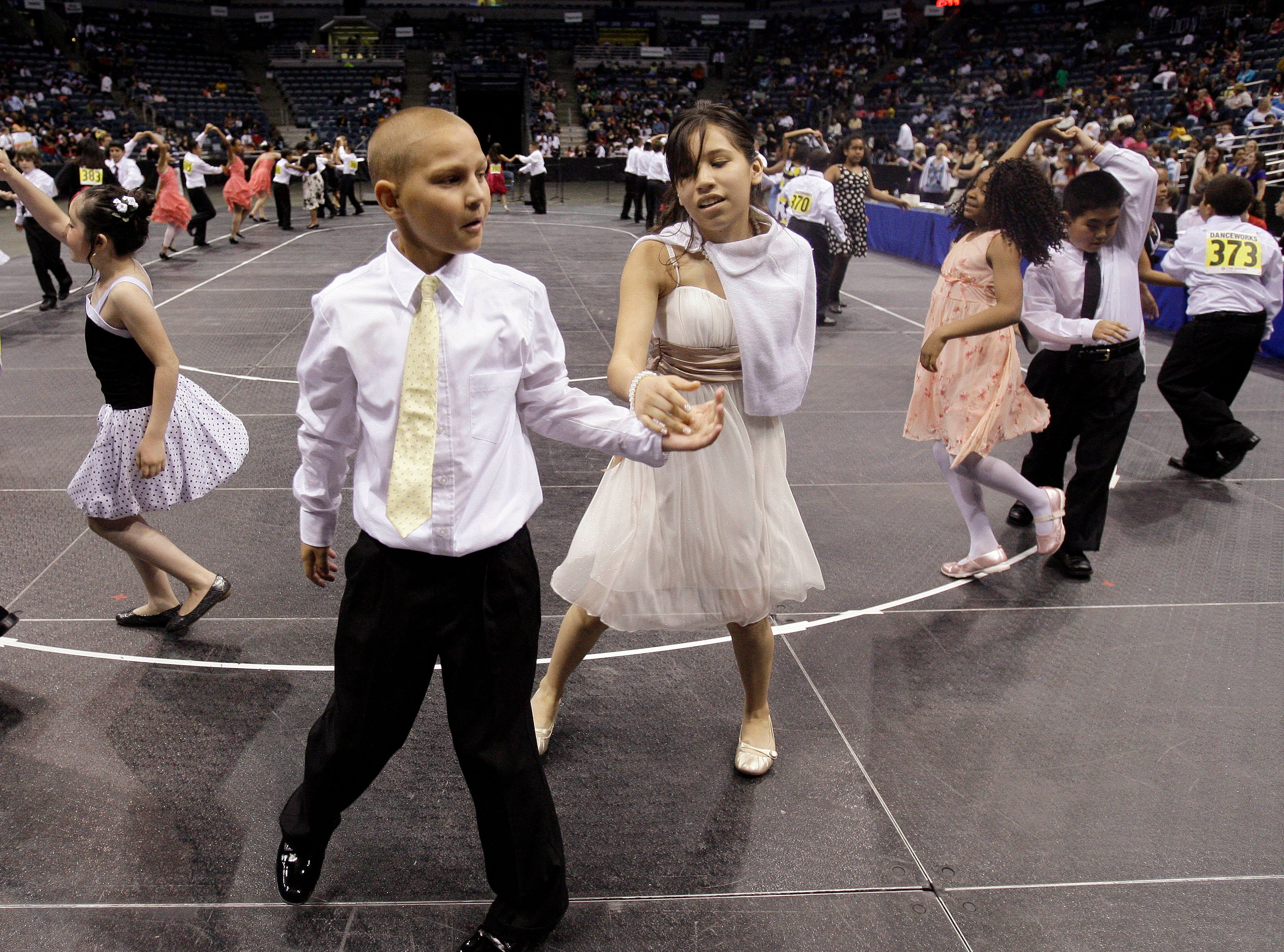2009: Fifth graders Aaron Nelson and Brianna Hernandez dance the swing during the Third Annual Mad Hot Ballroom and Tap Competition at the Bradley Center.
