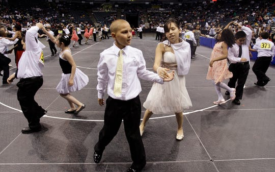 2009: Fifth graders Aaron Nelson and Brianna Hernandez dance the swing during the Third Annual Mad Hot Ballroom and Tap Competition at the Bradley Center. This year's event is Jan. 24 at the UW-Milwaukee Panther Arena.