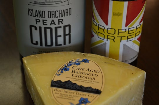 Bleu Mont Dairy Co. has a cave aged bandaged cheddar, which is wrapped in a cloth bandage and aged in a cave. Zak Groh, food consultant at Larry's Market in Brown Deer, recommended pairing it with Island Orchard Pear Cider.
