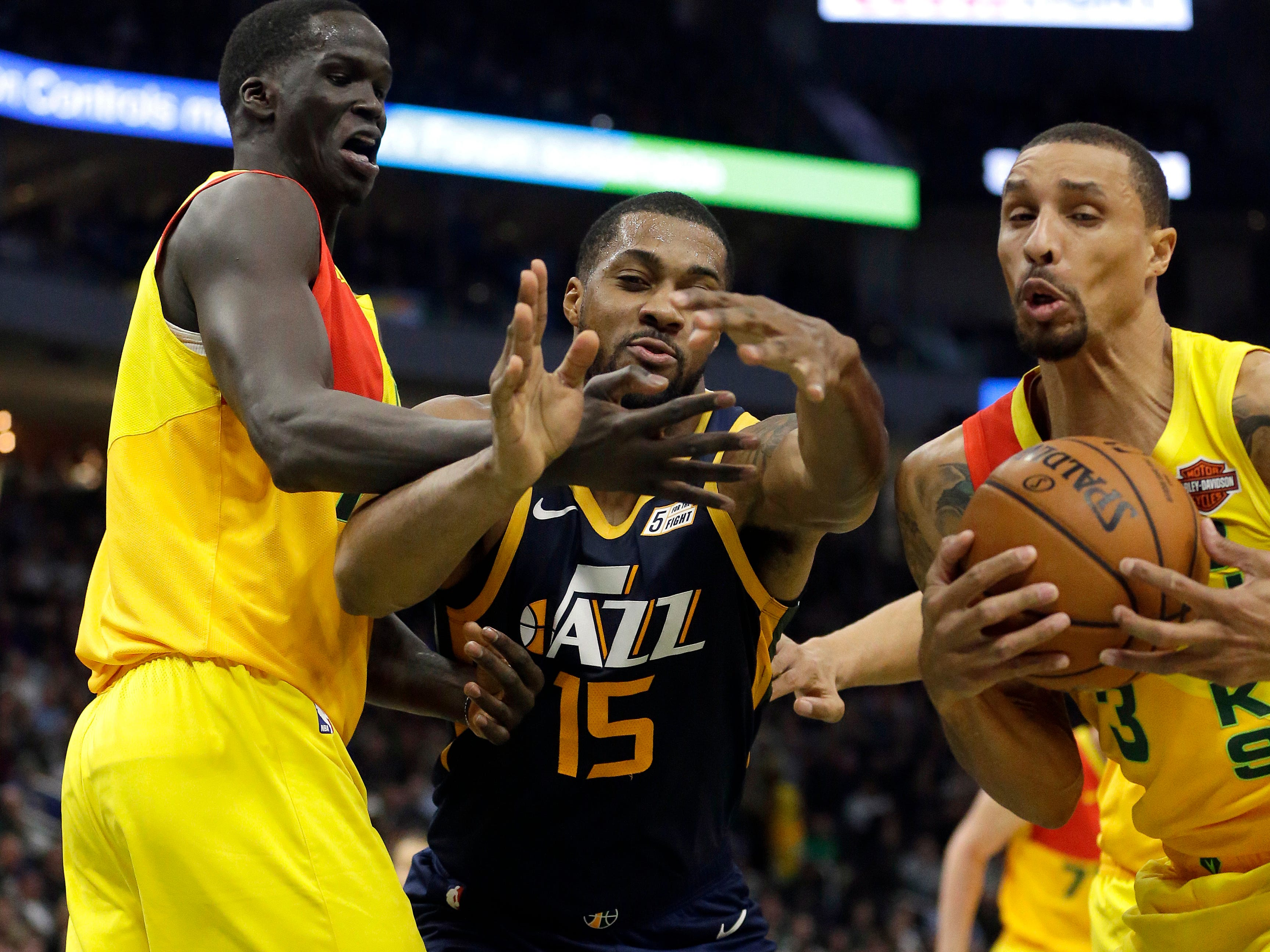 George Hill (right) of the Bucks steals the ball from the Jazz's Derrick Favors on Monday night.