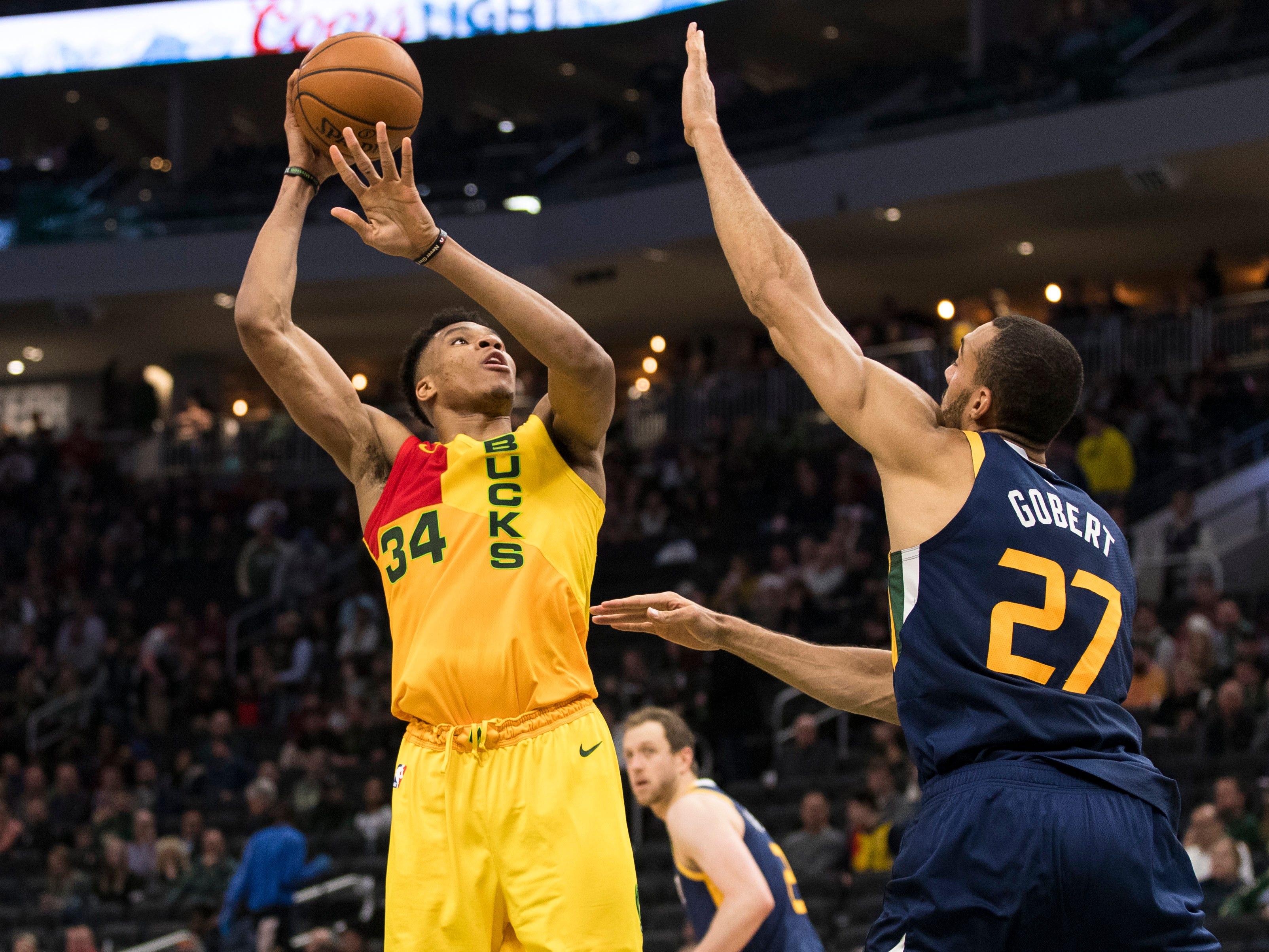 Bucks forward Giannis Antetokounmpo puts up a shot over Jazz center Rudy Gobert during the third quarter on Monday.