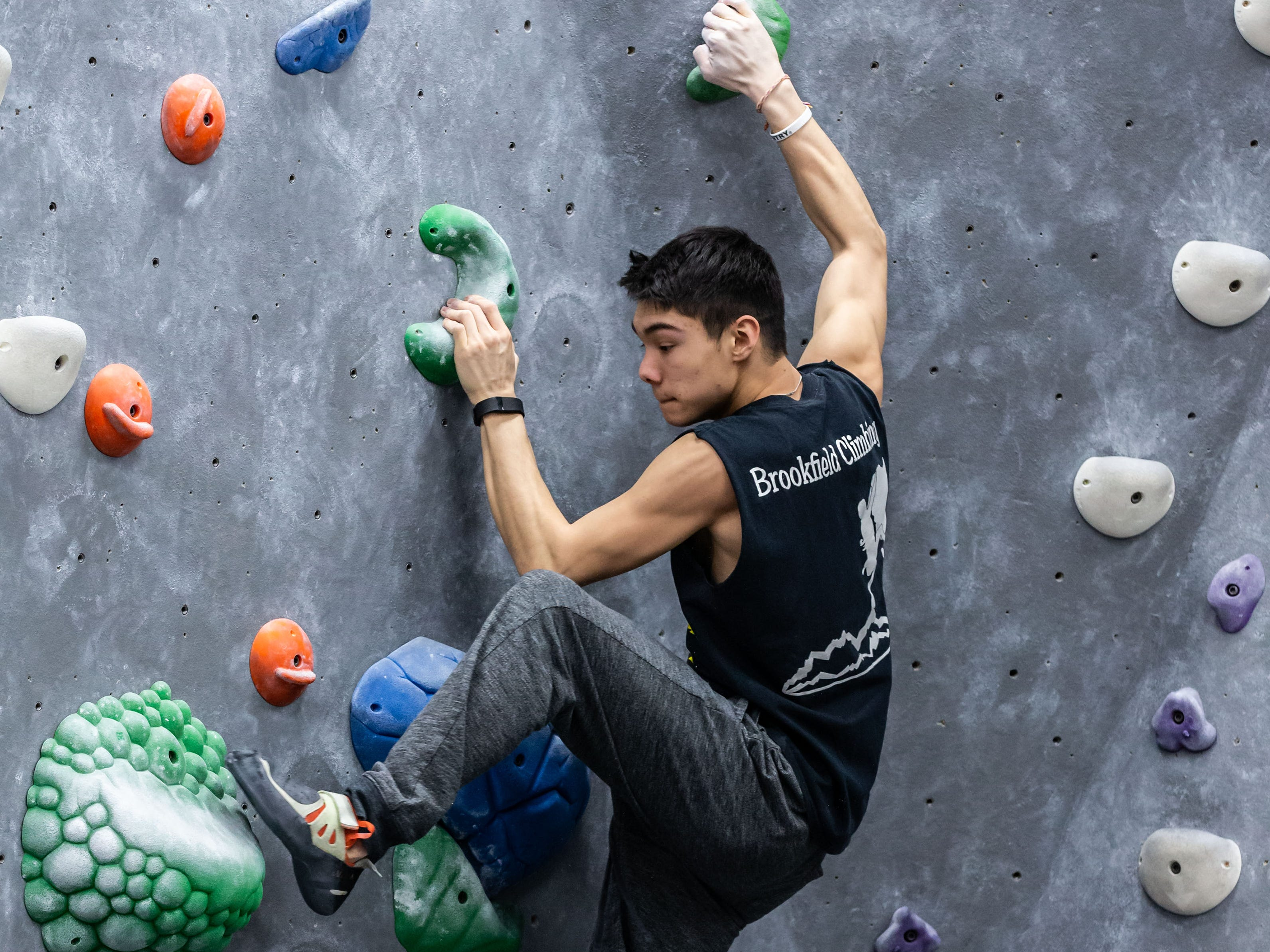 Brookfield East junior Blake Bautch scales a bouldering wall during practice with his high school climbing team at Adventure Rock in Brookfield on Monday, Jan. 7, 2019.