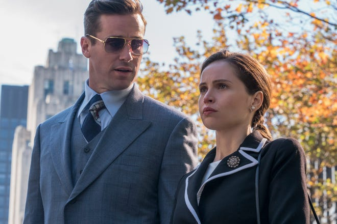 """Ruth Bader Ginsburg (Felicity Jones, right) and her husband, Marty Ginsburg (Armie Hammer) head for court in """"On the Basis of Sex."""""""