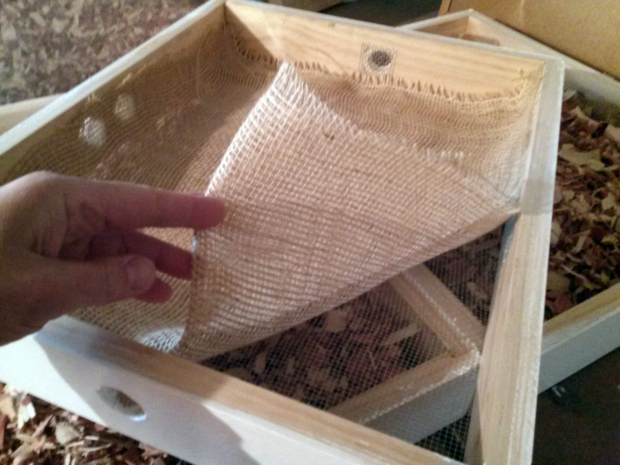 """""""Quilting boxes"""" with burlap, cedar chips and screened holes improve ventilation in the hive and reduce condensation in winter. Beekeeper Gemma Tarlach built these boxes herself."""