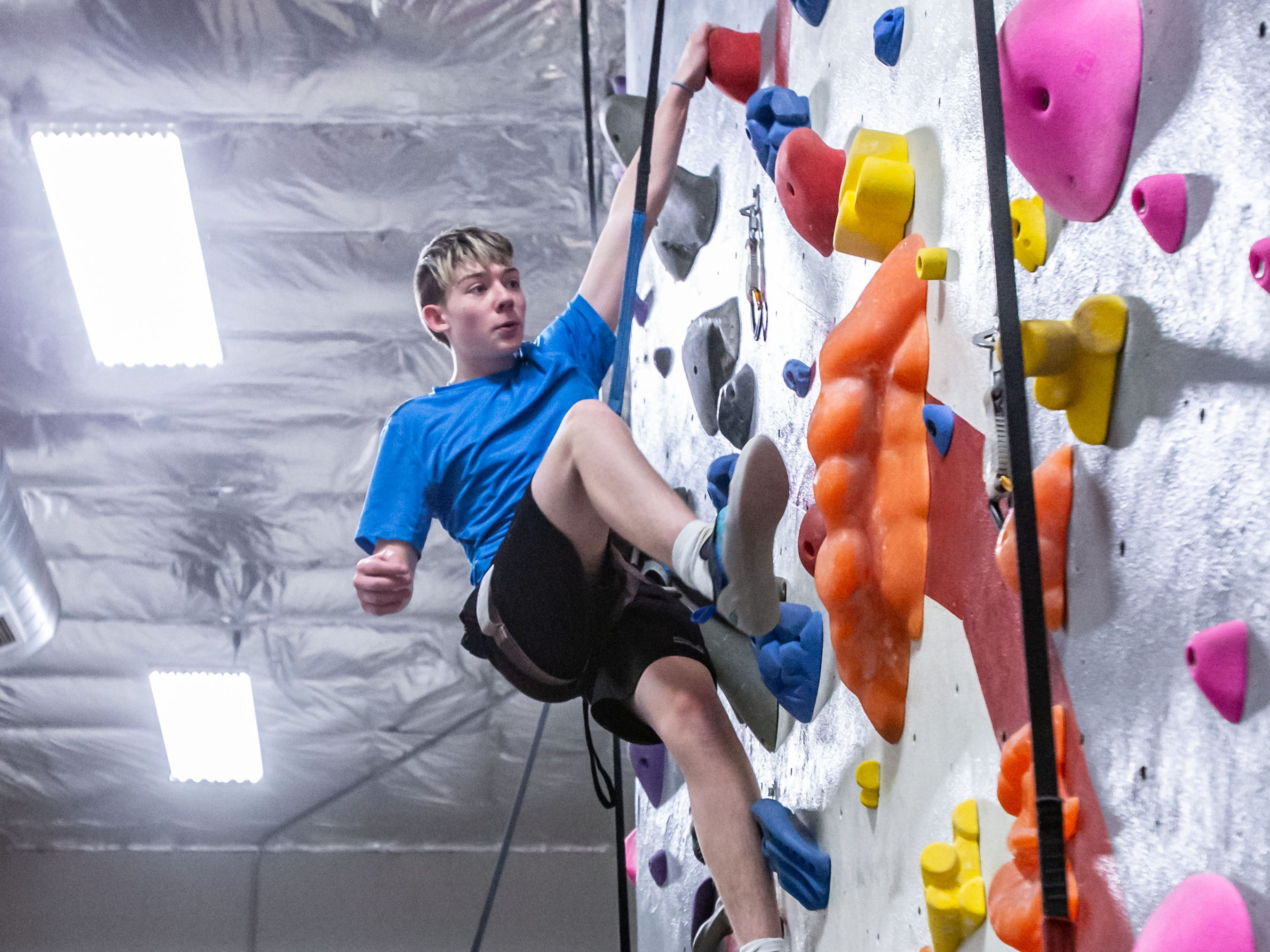 Oconomowoc freshman Zander Boettcher scales a wall during practice with his high school climbing team at Adventure Rock in Brookfield on Monday, Jan. 7, 2019.