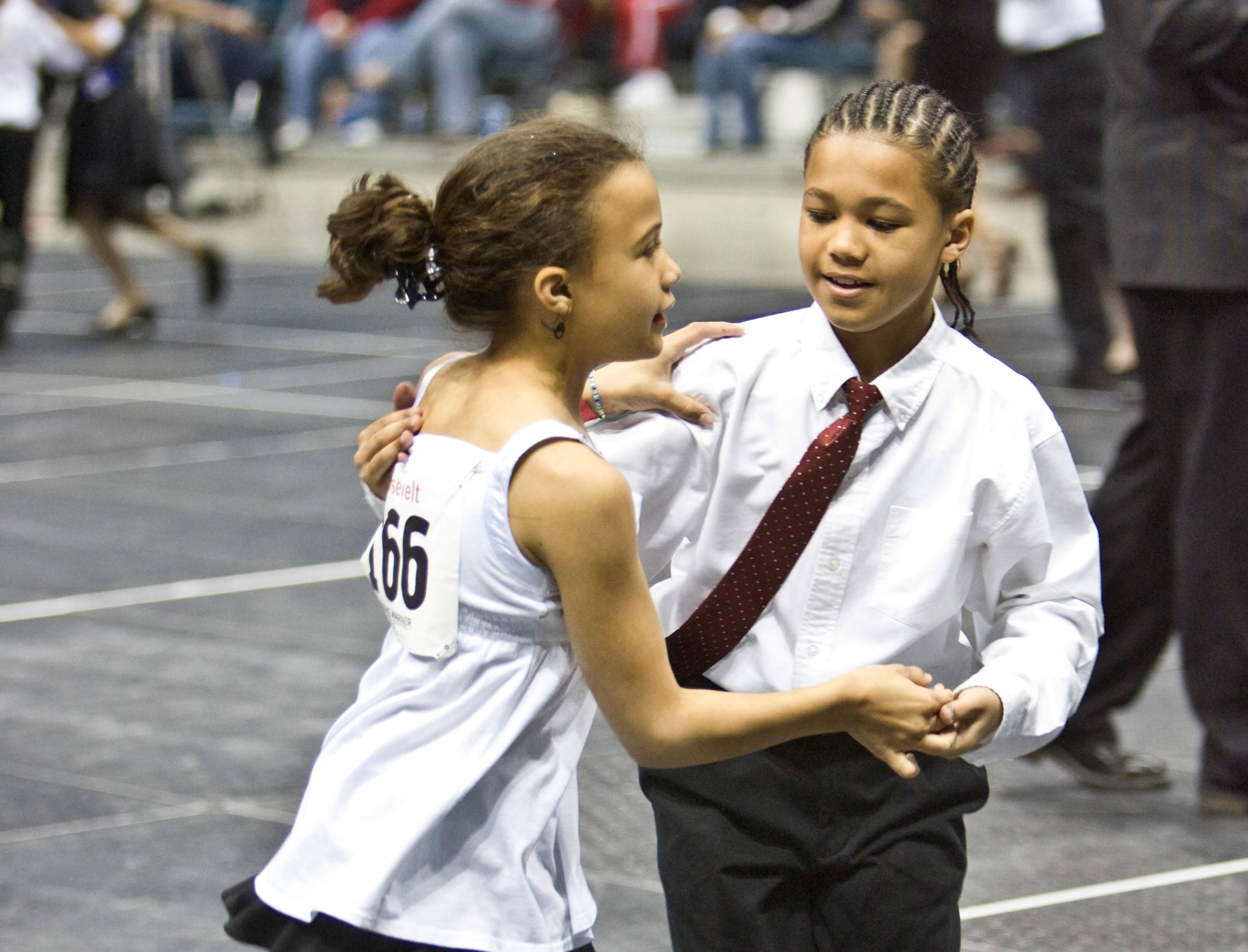 2008: Alexis Smith, 10, and Maliek Johnson-Payne, 11, from Roosevelt School, swing dance during the 2nd Annual Mad Hot Ballroom & Tap Competition at the Bradley Center. Fourth, 5th and 6th grade students from 35 participating Milwaukee public and private schools competed in ballroom and tap dancing.