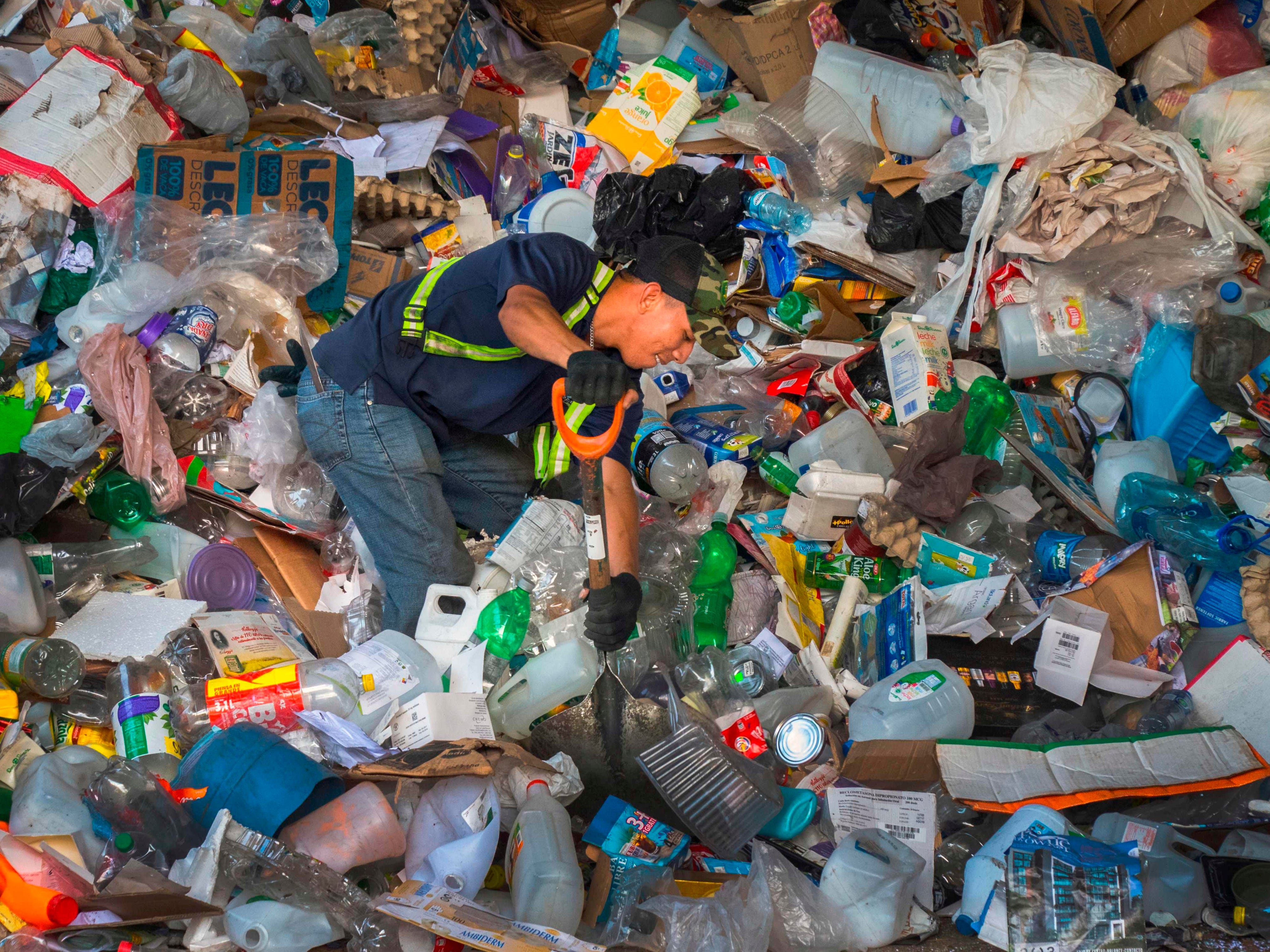 A worker arranges recyclable waste at La Sylvia recycling center in Barva,  Costa Rica on June 20, 2018.