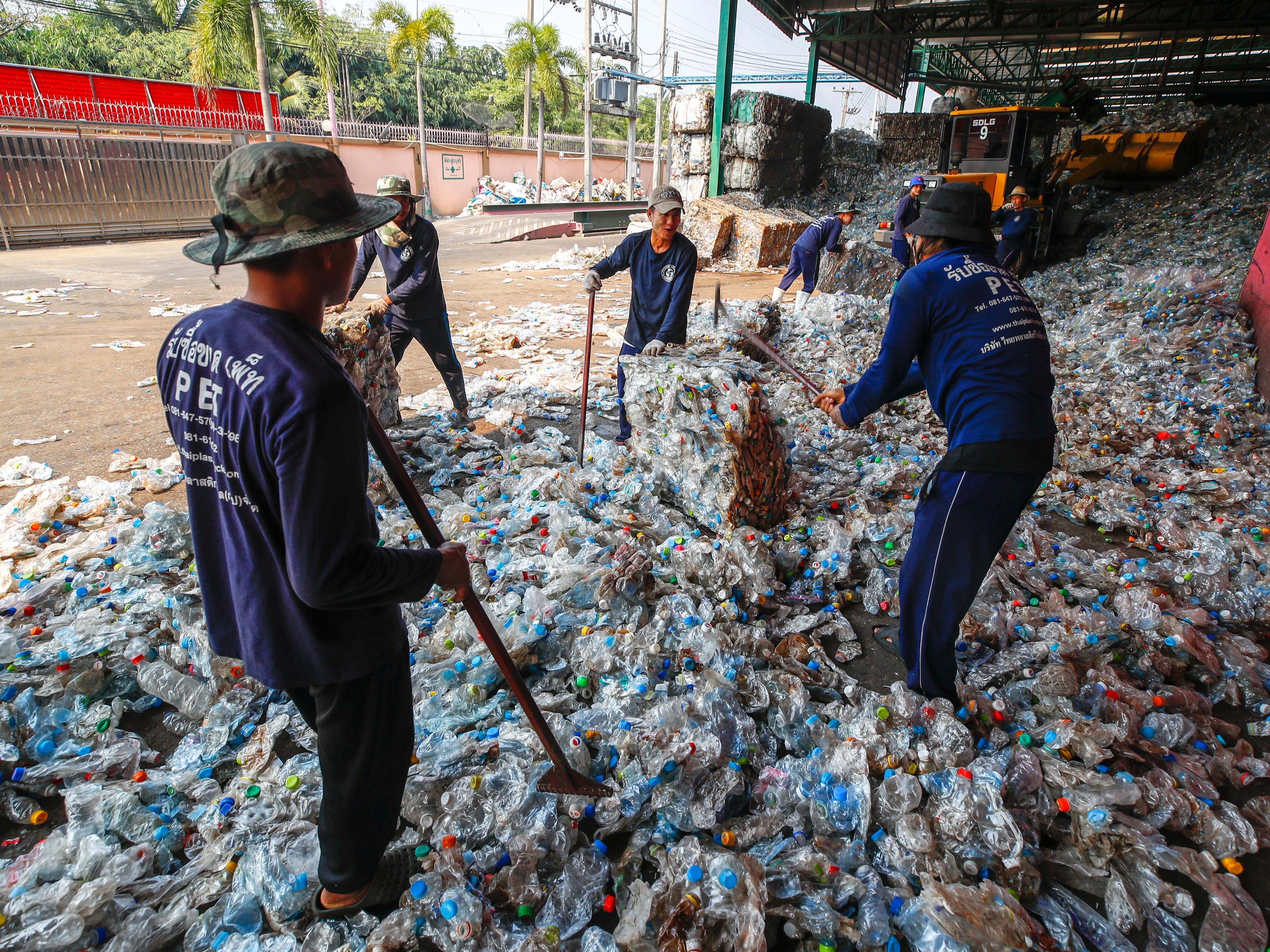 Migrant workers break apart blocks of pressed plastic bottles at a recycling plant near Bangkok, Thailand in  December 2018. According to Thailand's Ministry of Environment, Thailand produces about 2 million tons of plastic garbage every year and of that only half a million ton is reused or recycled. Research shows that the Asian countries of China, Indonesia, the Philippines, Vietnam and Thailand dump more roughly 60 percent of the world's plastic into oceans worldwide, more than the rest of the world combined.