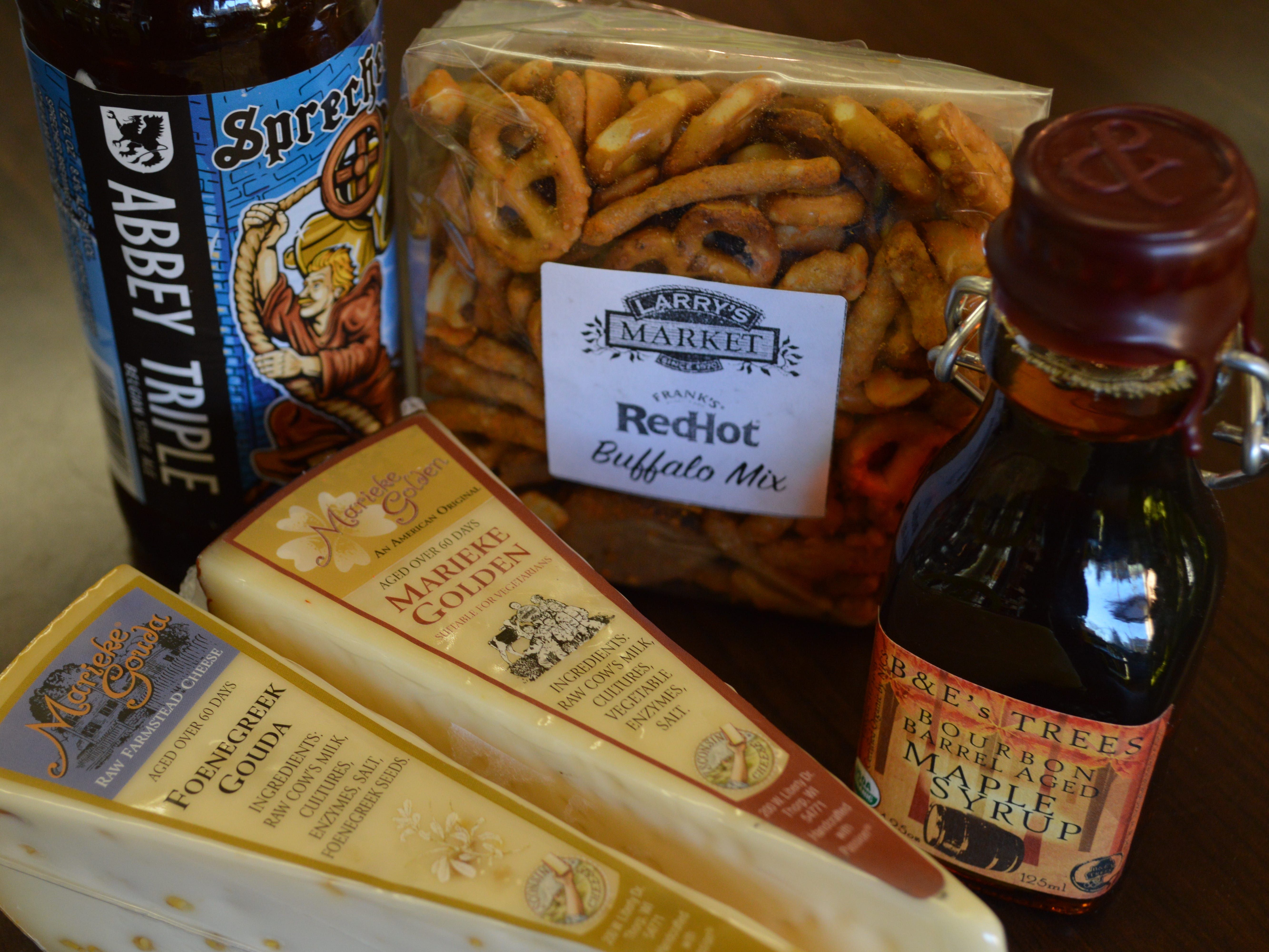 Since Goudas like Foenegreek Gouda by Marieke Gouda have richer, maltier flavors, Groh recommended pairing this kind of cheese with a beer like Sprecher Brewing Company's Abbey Triple.To bring out the cheese's sweet, maple flavor even more, he suggested drizzling it with maple syrup.