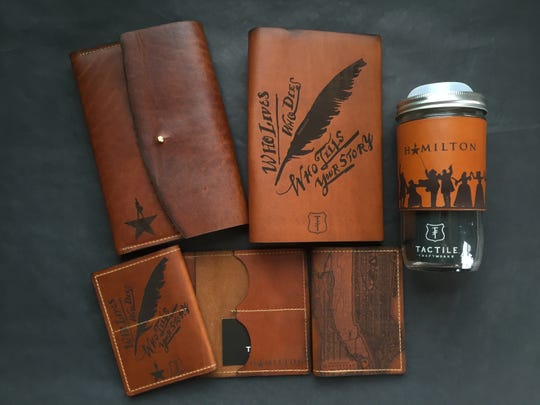 "Milwaukee leather goods maker Tactile Craftworks' is making souvenirs for the hit Broadway musical ""Hamilton."""