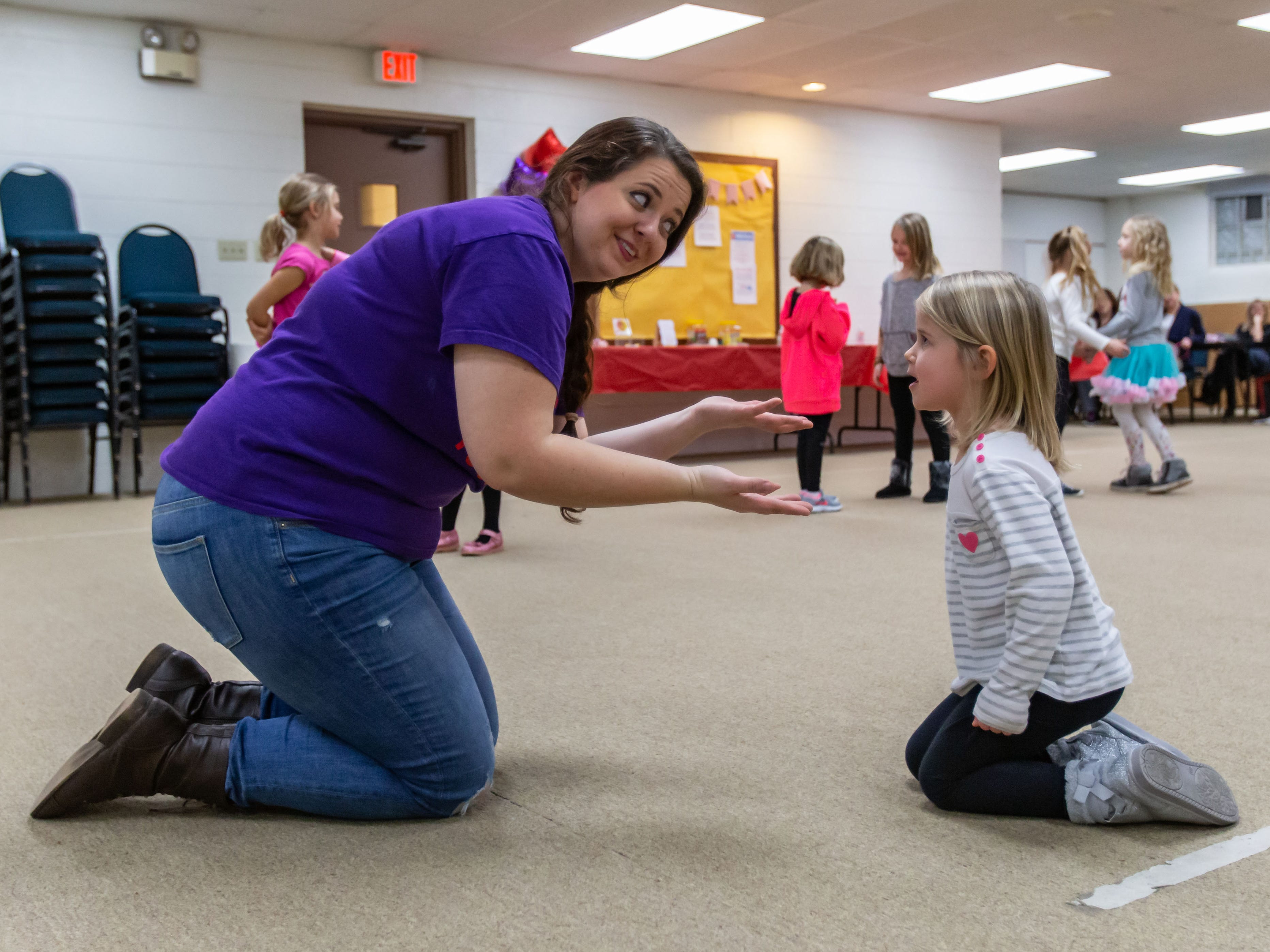 Lake Country Playhouse teaching artist Kathryn Mooers works with a youngster during a free, Open House theatre class in Hartland on Monday, Jan. 7, 2019. For more information visit LakeCountryPlayhouseWI.org.