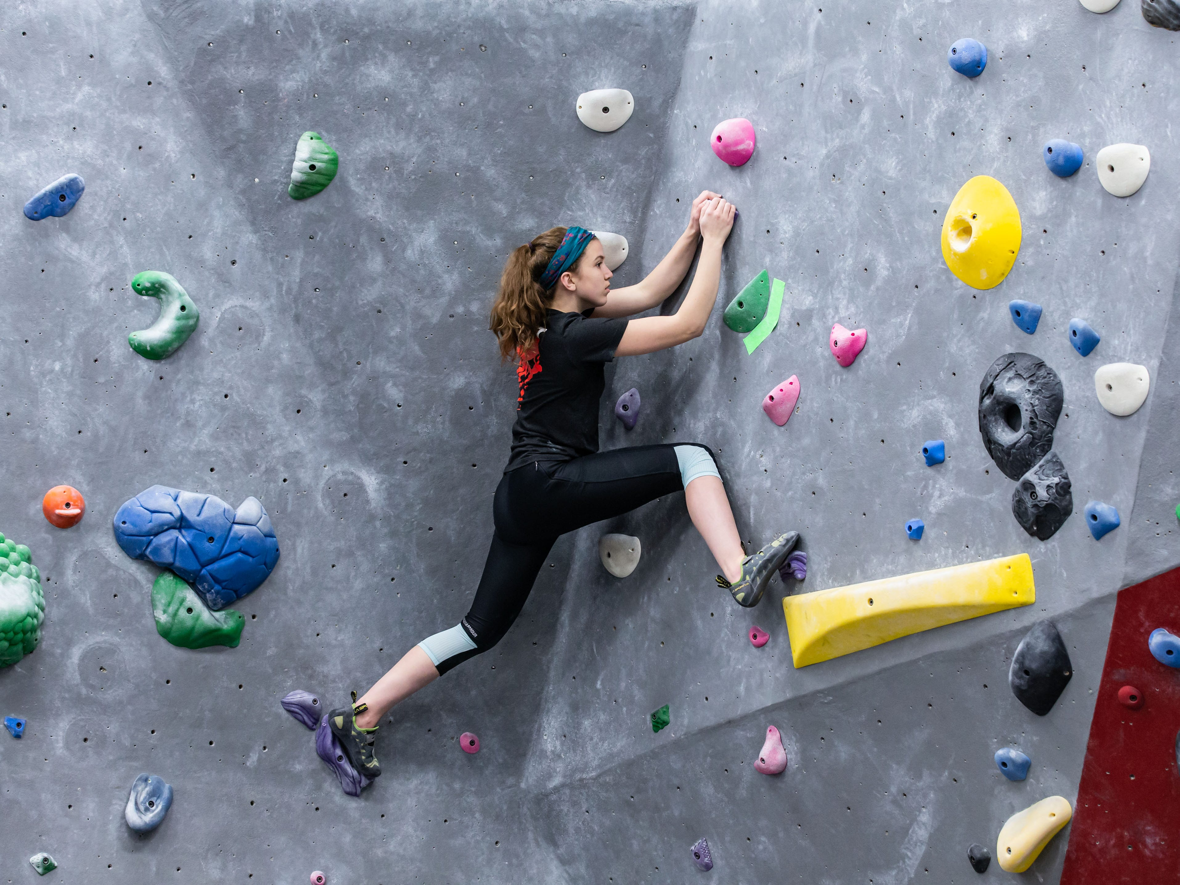 Brookfield East junior Leah Eddinger scales a bouldering wall during practice with her high school climbing team at Adventure Rock in Brookfield on Monday, Jan. 7, 2019.