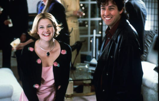 "Drew Barrymore (left) and Adam Sandler star in the 1998 romantic comedy ""The Wedding Singer."""