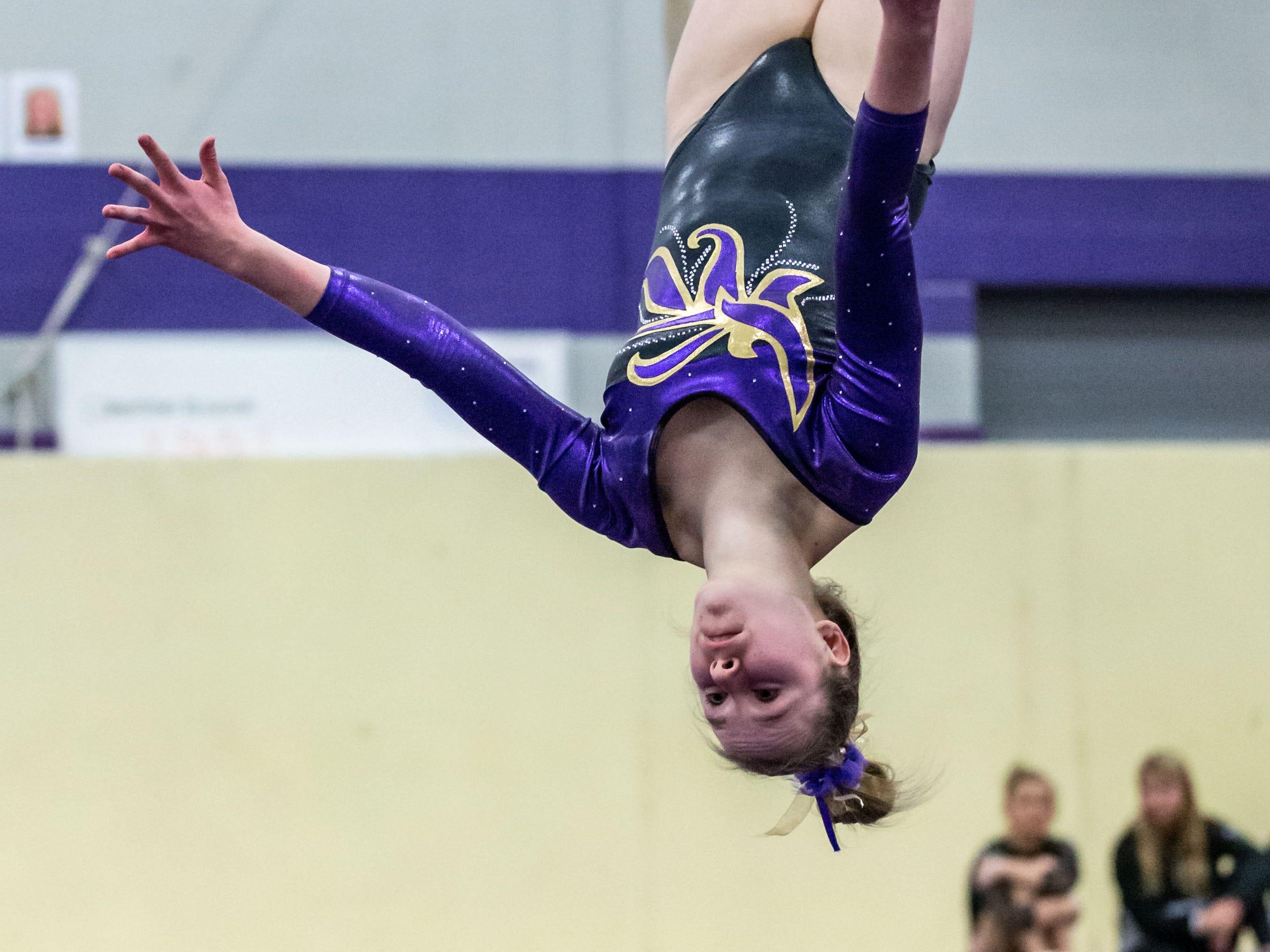 Oconomowoc gymnast Iris Laabs competes on the floor during the tri-meet at Oconomowoc on Thursday, Jan. 3, 2019.