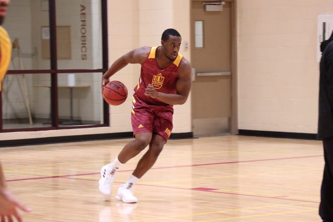 Shelby (pictured), a 6-foot-4, 256-pound defensive end, joined the ULM men's basketball team in December.
