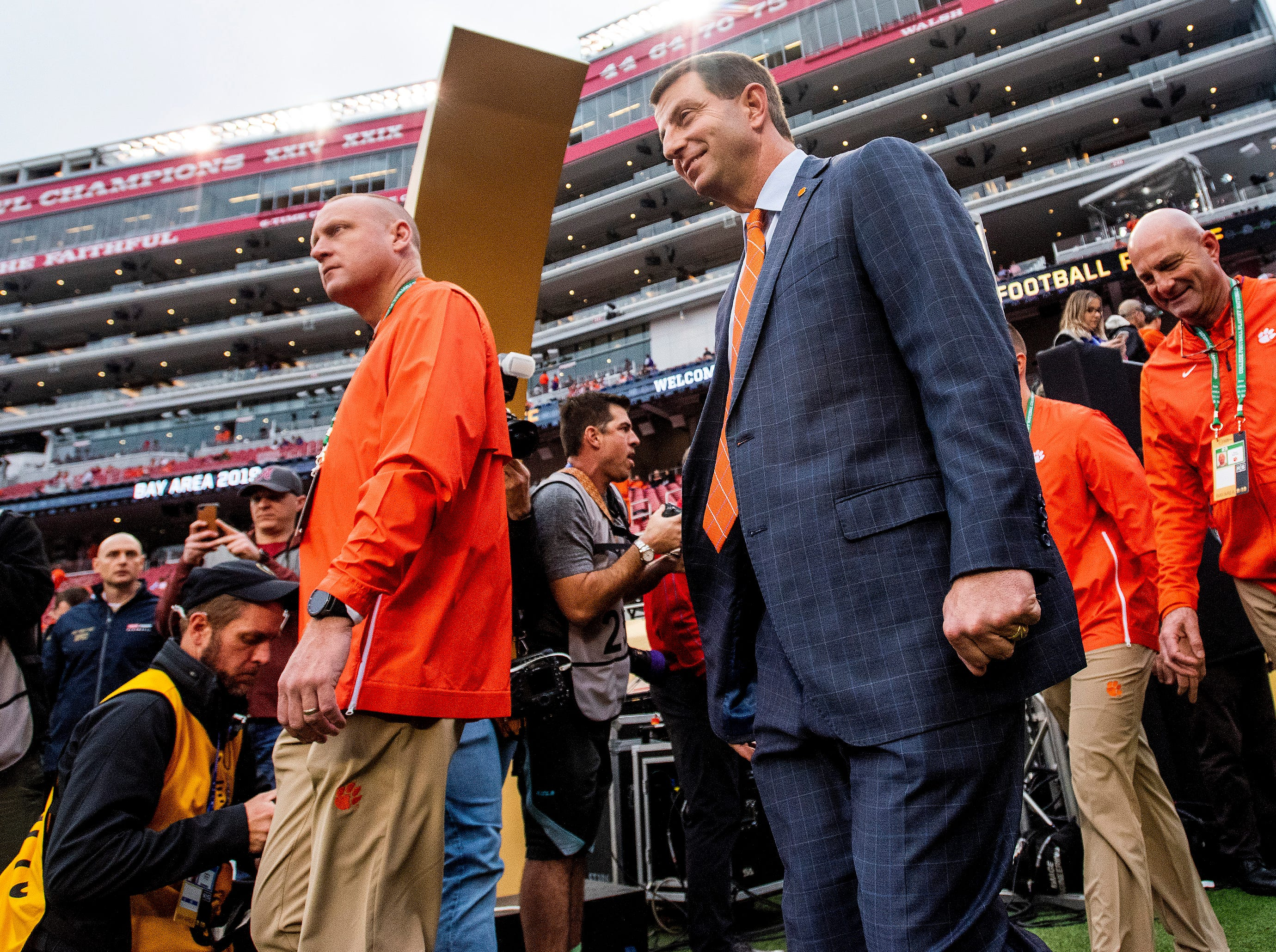 Clemson head coach Dabo Swinney walks the field as the teams arrive the College Football Playoff National Championship game at Levi's Stadium in Santa Clara, Ca., on Monday January 7, 2019.