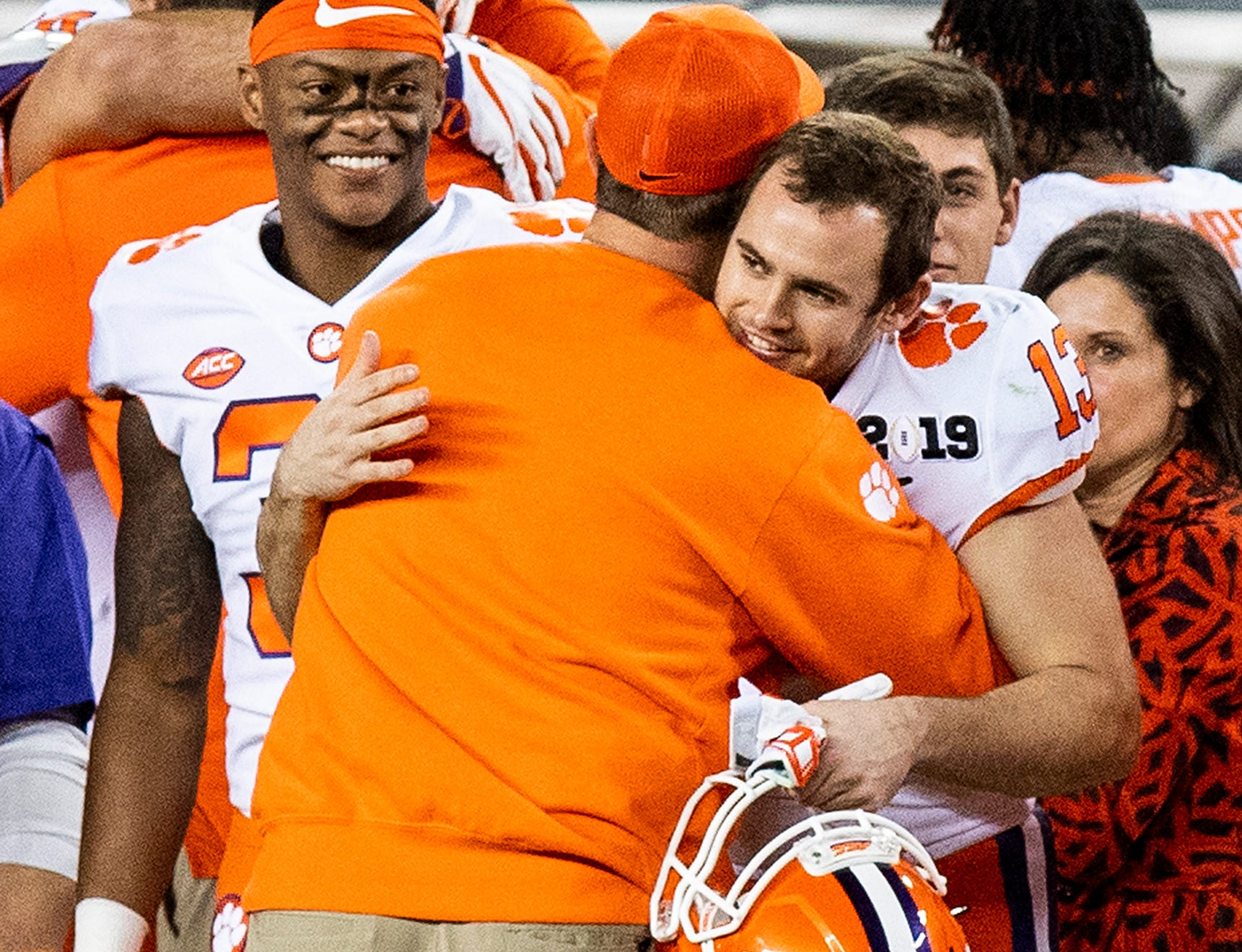 Clemson head coach Dabo Swinney hugs Clemson wide receiver Hunter Renfrow (13) as time runs out in their win over Alabama in the College Football Playoff National Championship game at Levi's Stadium in Santa Clara, Ca., on Monday January 7, 2019.