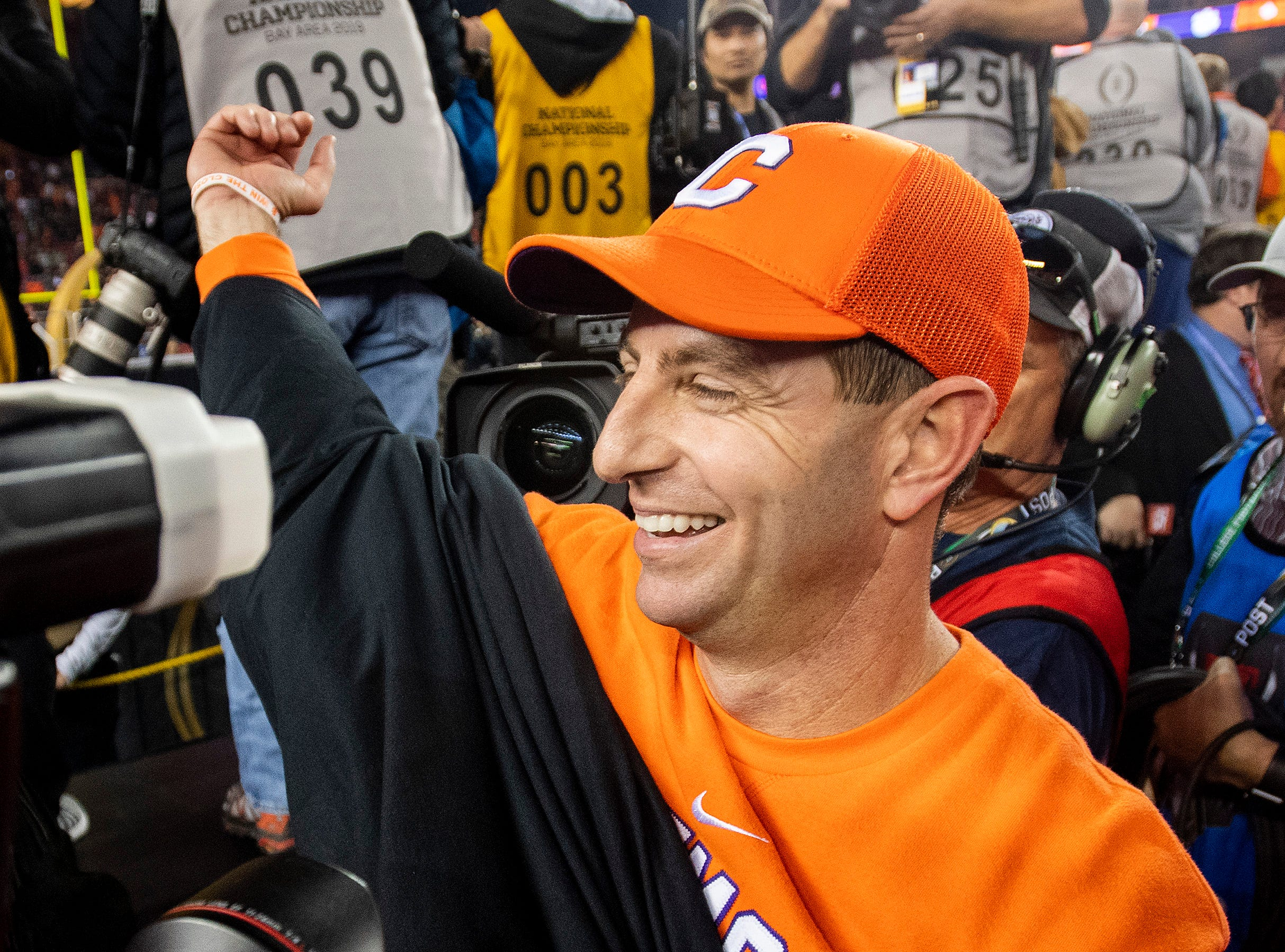 Clemson head coach Dabo Swinney puts on a national championship t-shirt after defeating Alabama in the College Football Playoff National Championship game at Levi's Stadium in Santa Clara, Ca., on Monday January 7, 2019.