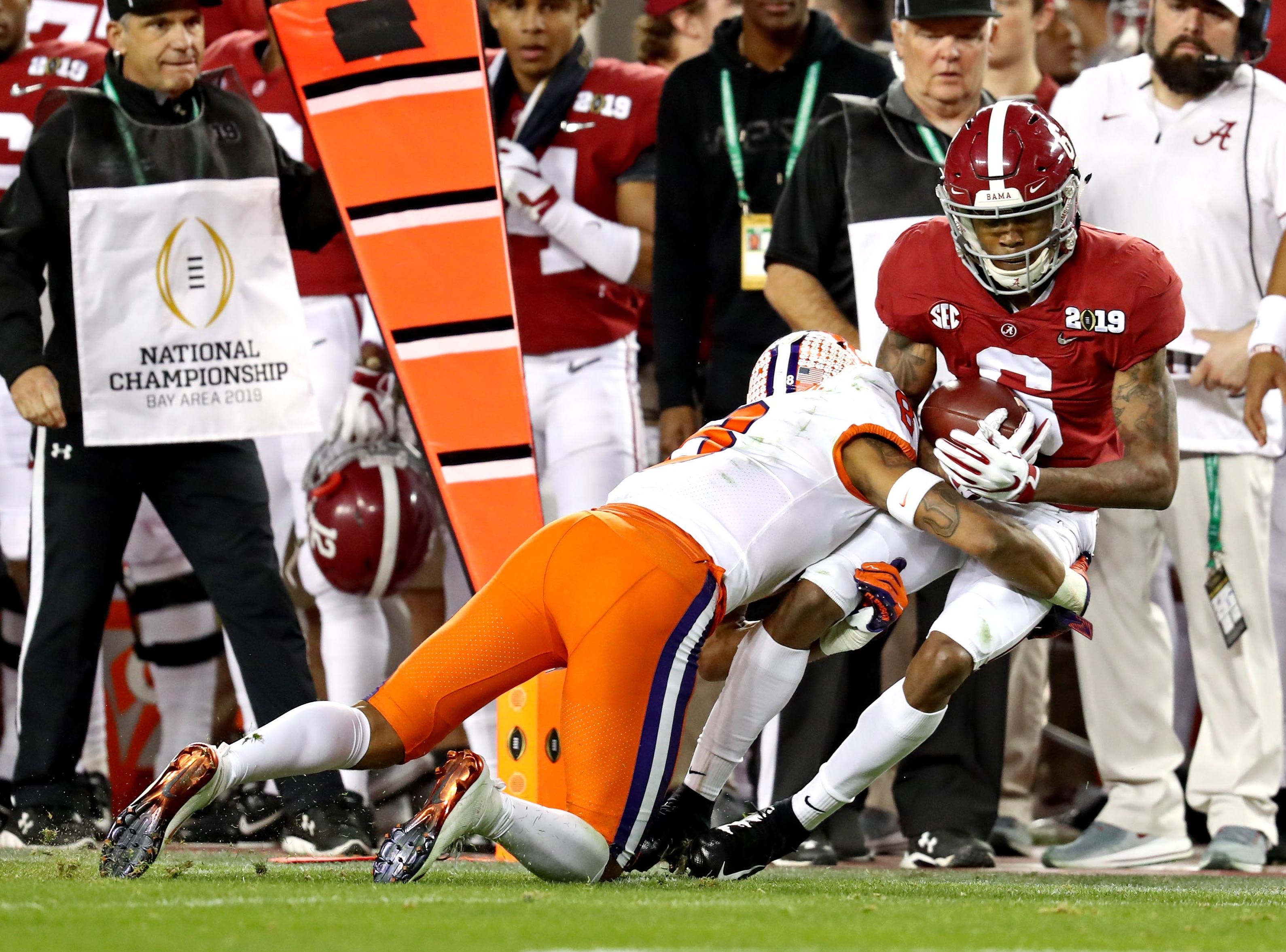 Jan 7, 2019; Santa Clara, CA, USA; Alabama Crimson Tide wide receiver DeVonta Smith (6) is tackled by Clemson Tigers cornerback A.J. Terrell (8) during the third quarter during the 2019 College Football Playoff Championship game at Levi's Stadium. Mandatory Credit: Matthew Emmons-USA TODAY Sports