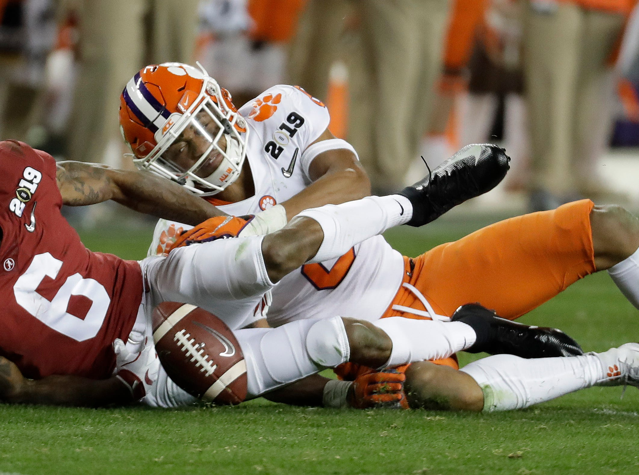 Alabama's DeVonta Smith recovers his own fumble during the second half of the NCAA college football playoff championship game against Clemson, Monday, Jan. 7, 2019, in Santa Clara, Calif. (AP Photo/Chris Carlson)