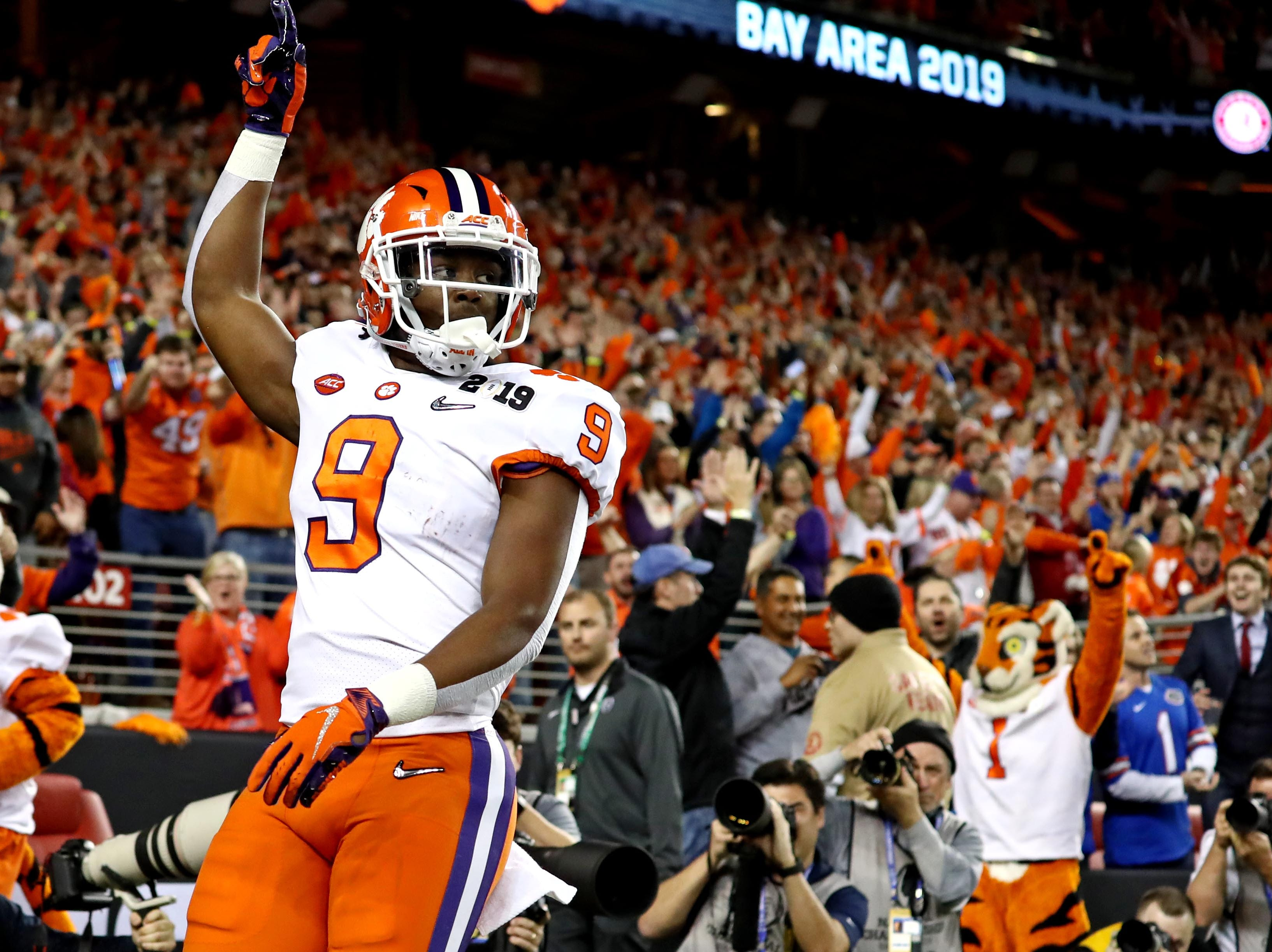 Jan 7, 2019; Santa Clara, CA, USA;  Clemson Tigers running back Travis Etienne (9) celebrates scoring a touchdown during the first quarter against the Alabama Crimson Tide during the 2019 College Football Playoff Championship game at Levi's Stadium. Mandatory Credit: Matthew Emmons-USA TODAY Sports