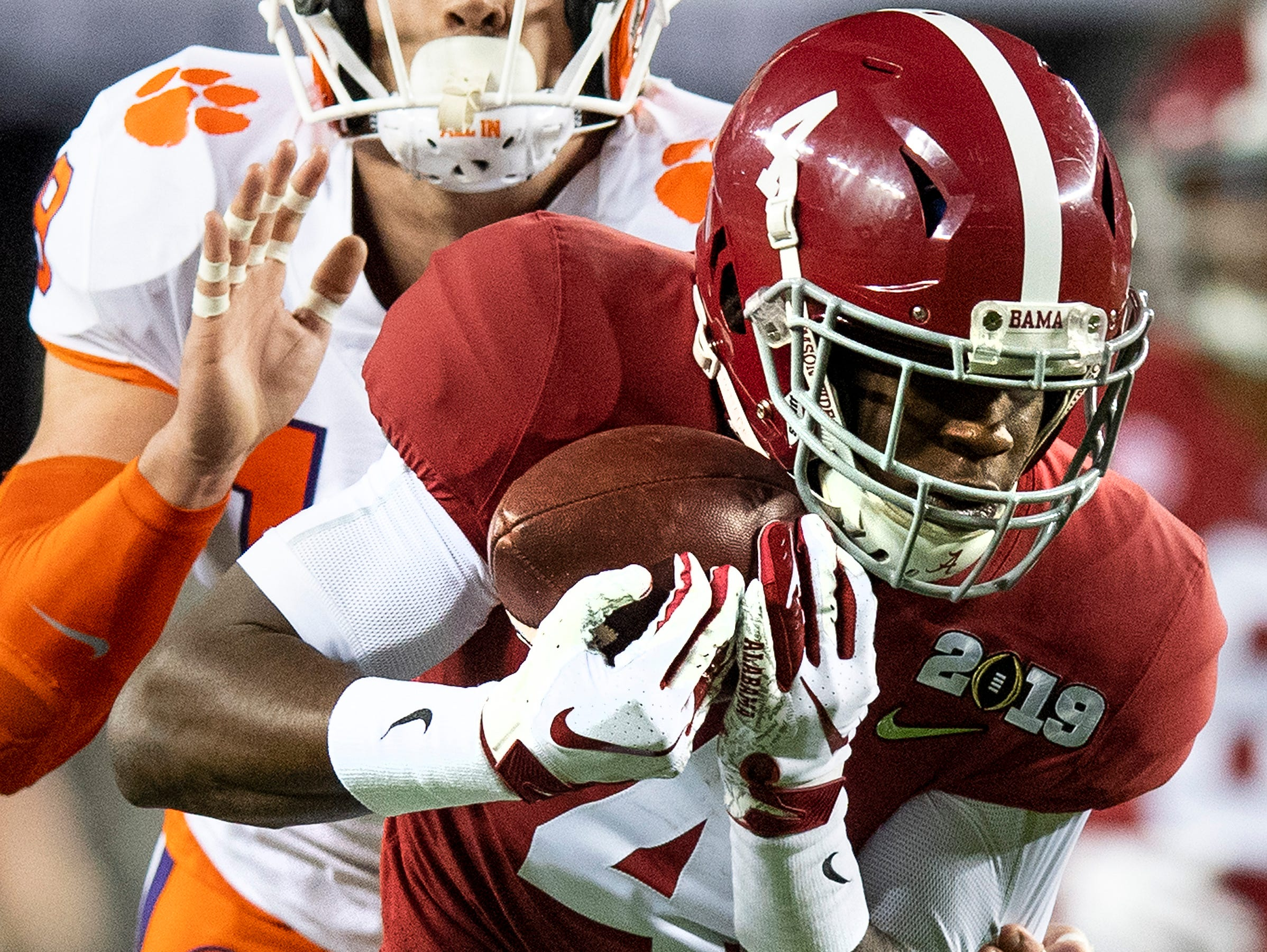 Alabama wide receiver Jerry Jeudy (4) catches a touchdown p[ass against Clemson safety Tanner Muse (19) In first half action of the College Football Playoff National Championship game at Levi's Stadium in Santa Clara, Ca., on Monday January 7, 2019.