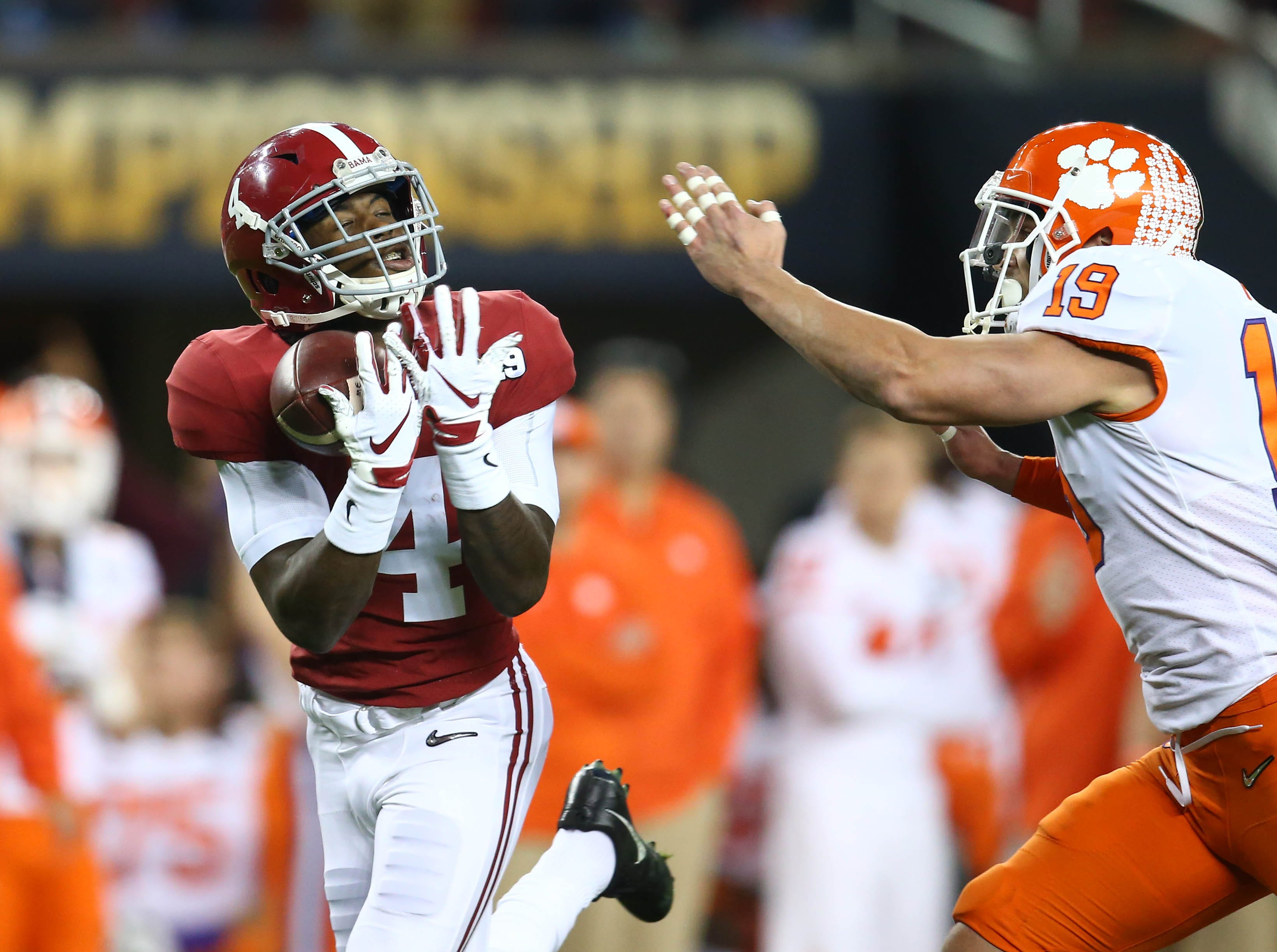 Jan 7, 2019; Santa Clara, CA, USA; Alabama Crimson Tide wide receiver Jerry Jeudy (4) catches a touchdown pass against Clemson Tigers safety Tanner Muse (19) during the 2019 College Football Playoff Championship game at Levi's Stadium. Mandatory Credit: Mark J. Rebilas-USA TODAY Sports