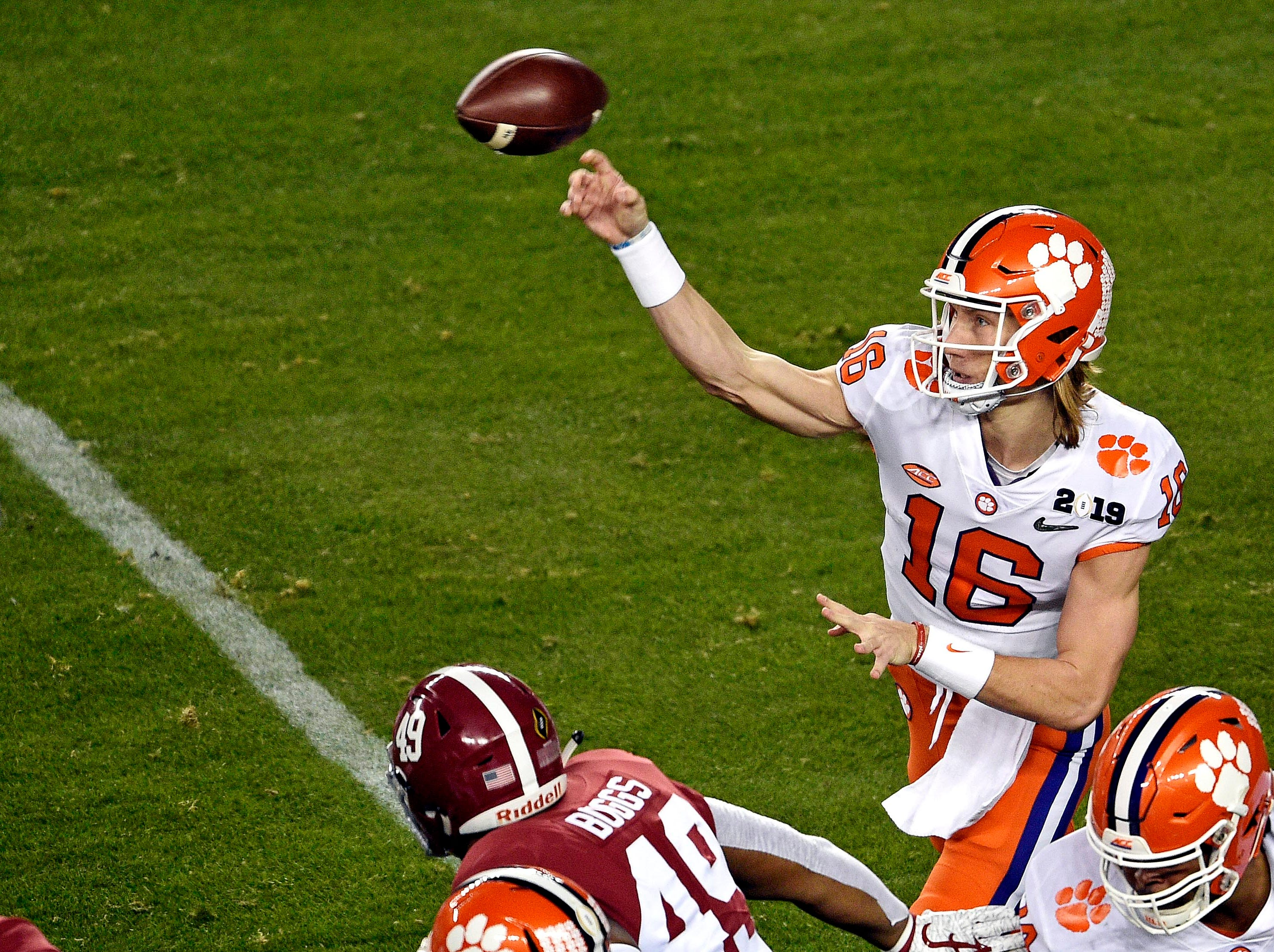 Jan 7, 2019; Santa Clara, CA, USA; Clemson Tigers quarterback Trevor Lawrence (16) throws a pass during the first quarter against the Alabama Crimson Tide during the 2019 College Football Playoff Championship game at Levi's Stadium. Mandatory Credit: Kelvin Kuo-USA TODAY Sports