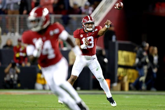 Jan 7, 2019; Santa Clara, CA, USA; Alabama Crimson Tide quarterback Tua Tagovailoa (13) throws a pass during the third quarter against the Clemson Tigers during the 2019 College Football Playoff Championship game at Levi's Stadium. Mandatory Credit: Matthew Emmons-USA TODAY Sports