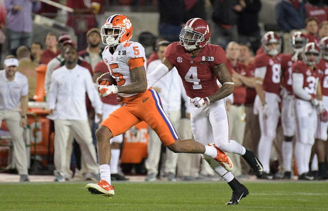 Jan 7, 2019; Santa Clara, CA, USA; Clemson Tigers wide receiver Tee Higgins (5) runs against Alabama Crimson Tide defensive back Saivion Smith (4) during the 2019 College Football Playoff Championship game at Levi's Stadium. Mandatory Credit: Kirby Lee-USA TODAY Sports